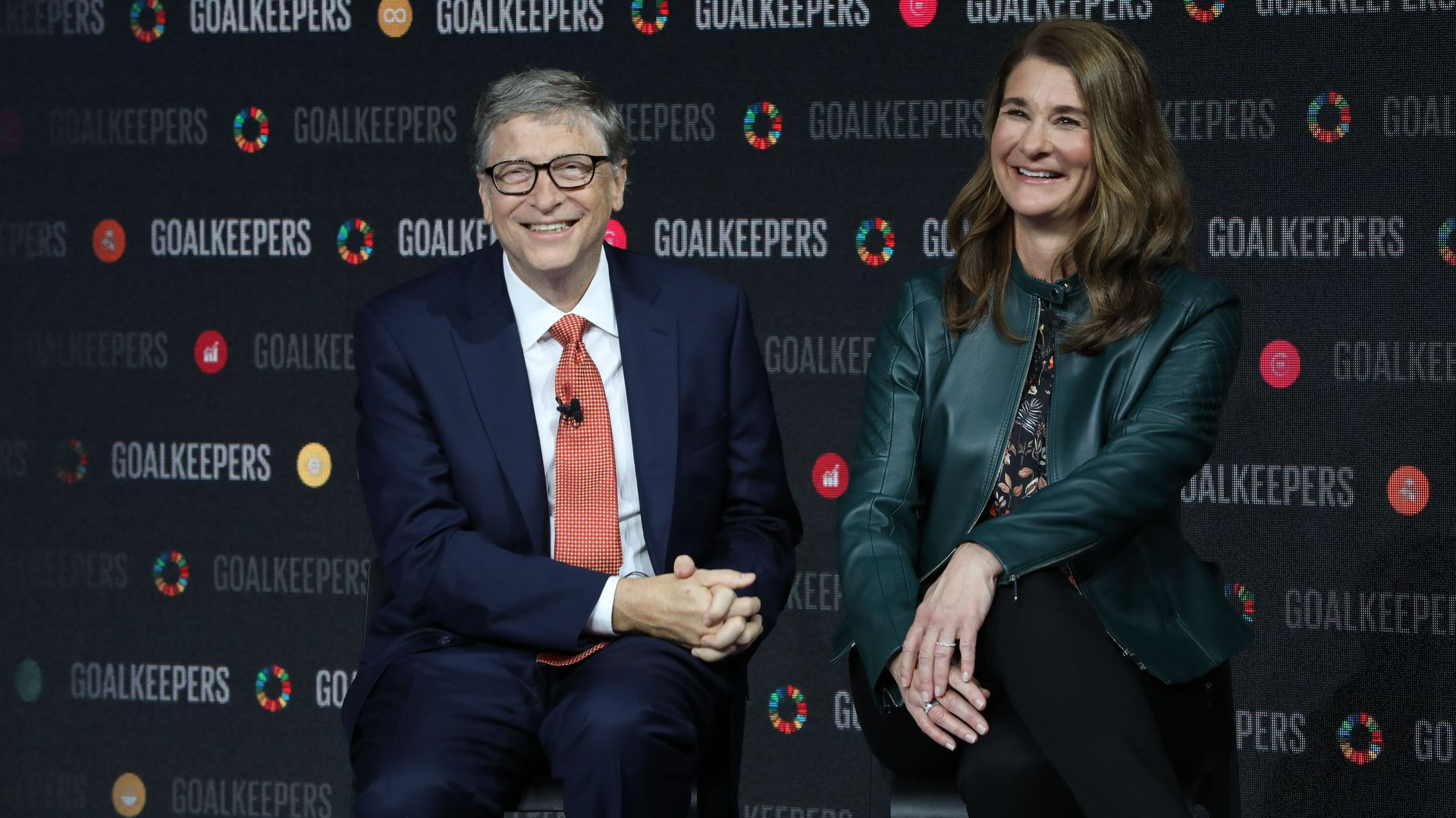 Bill and Melinda Gates on a step and repeat