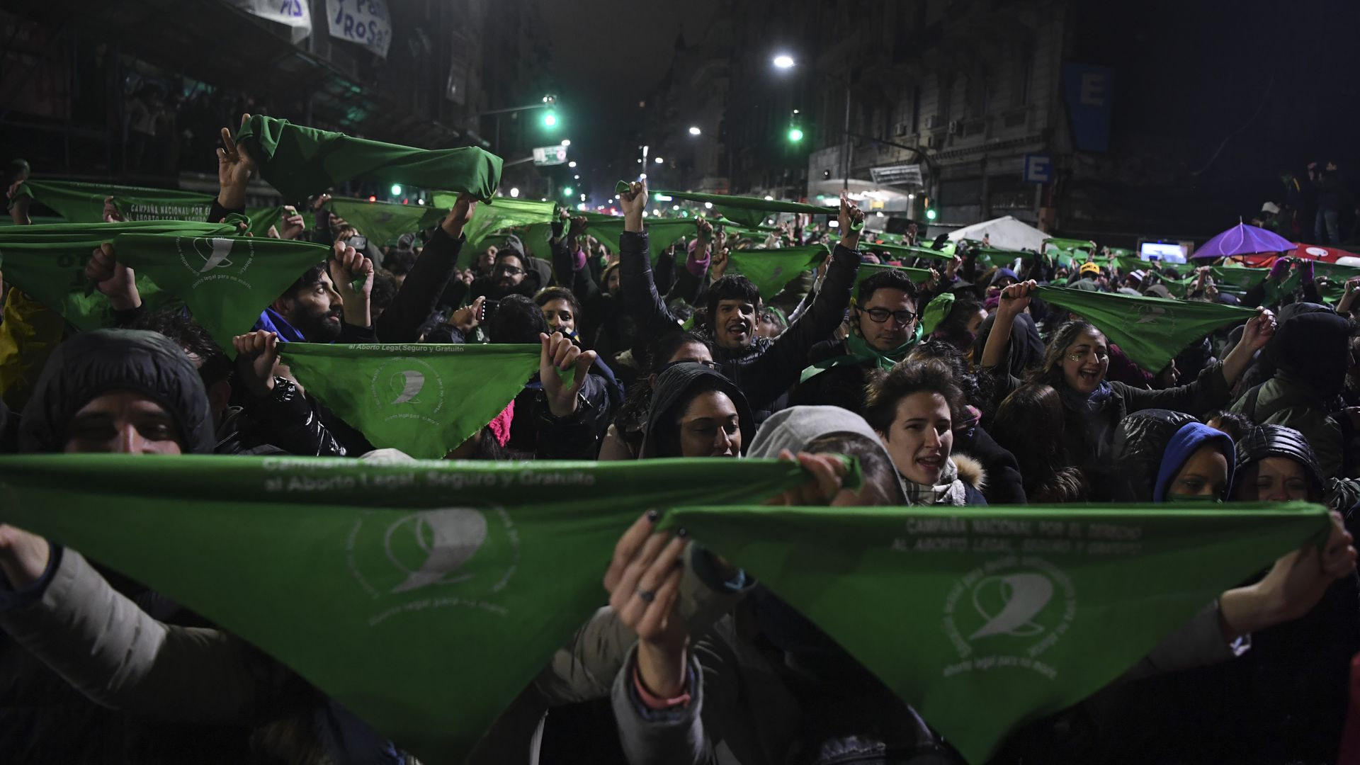 Argentine protestors hold up green bandanas