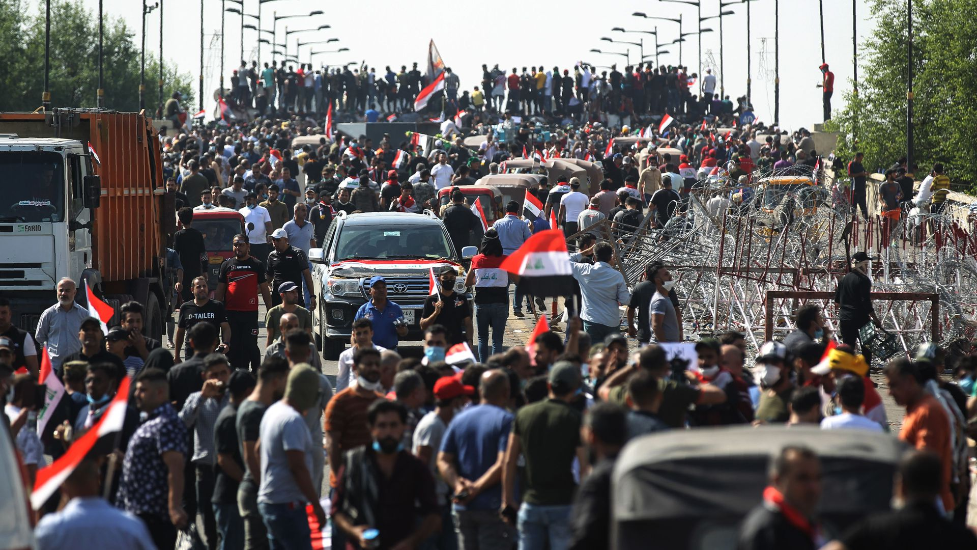 Iraqi protesters gather on the capital Baghdad's Al-Jumhuriyah Bridge