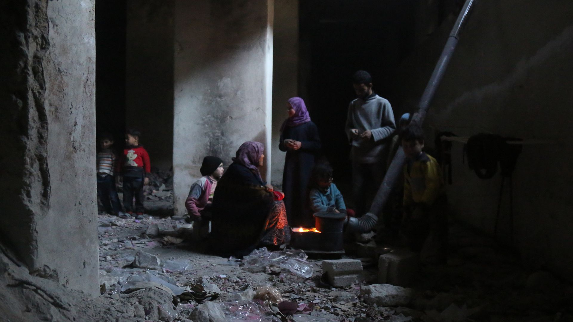 Syrians in basement of bombed-out building