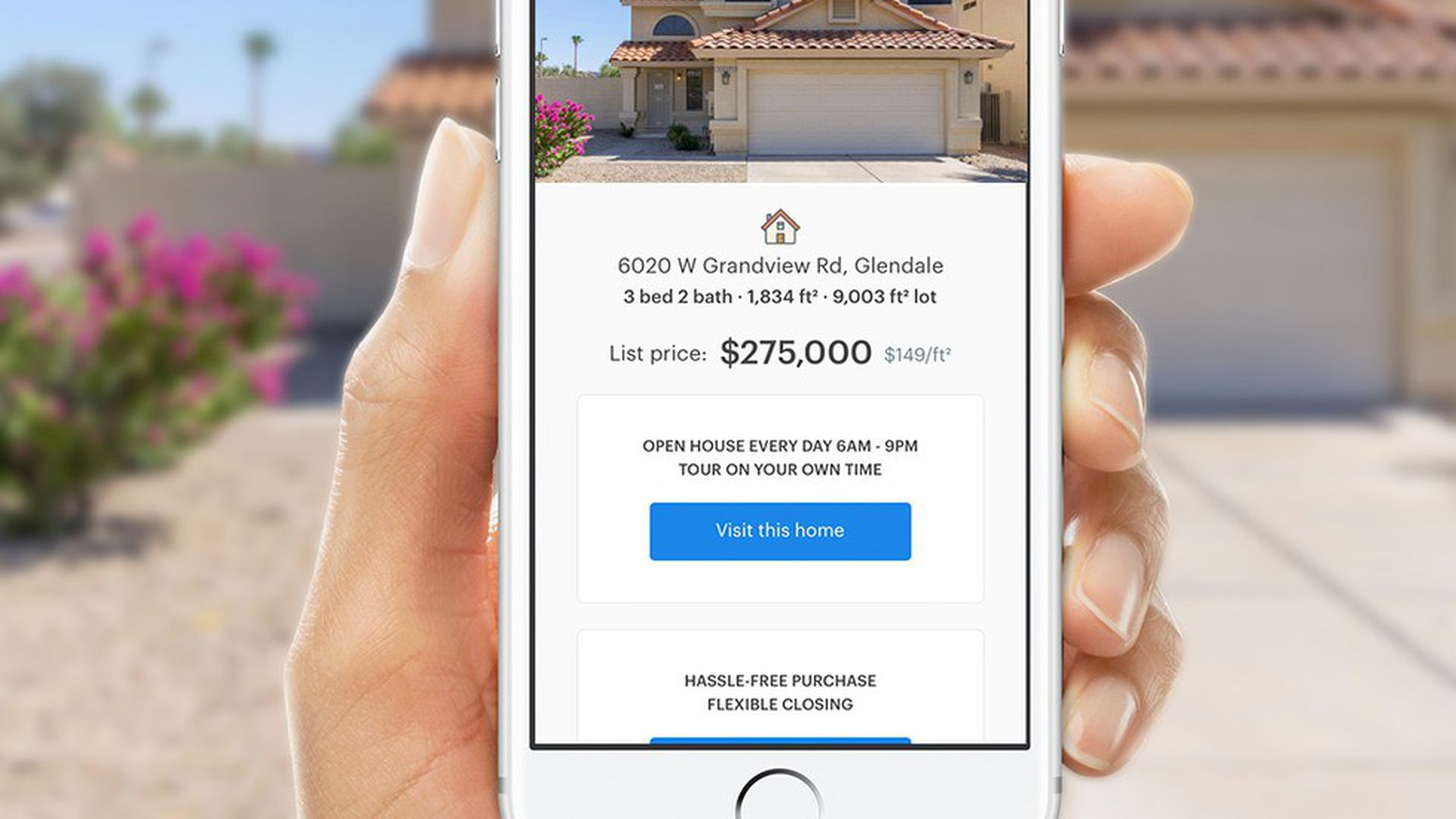 Hand holding Opendoor's home-buying mobile app.