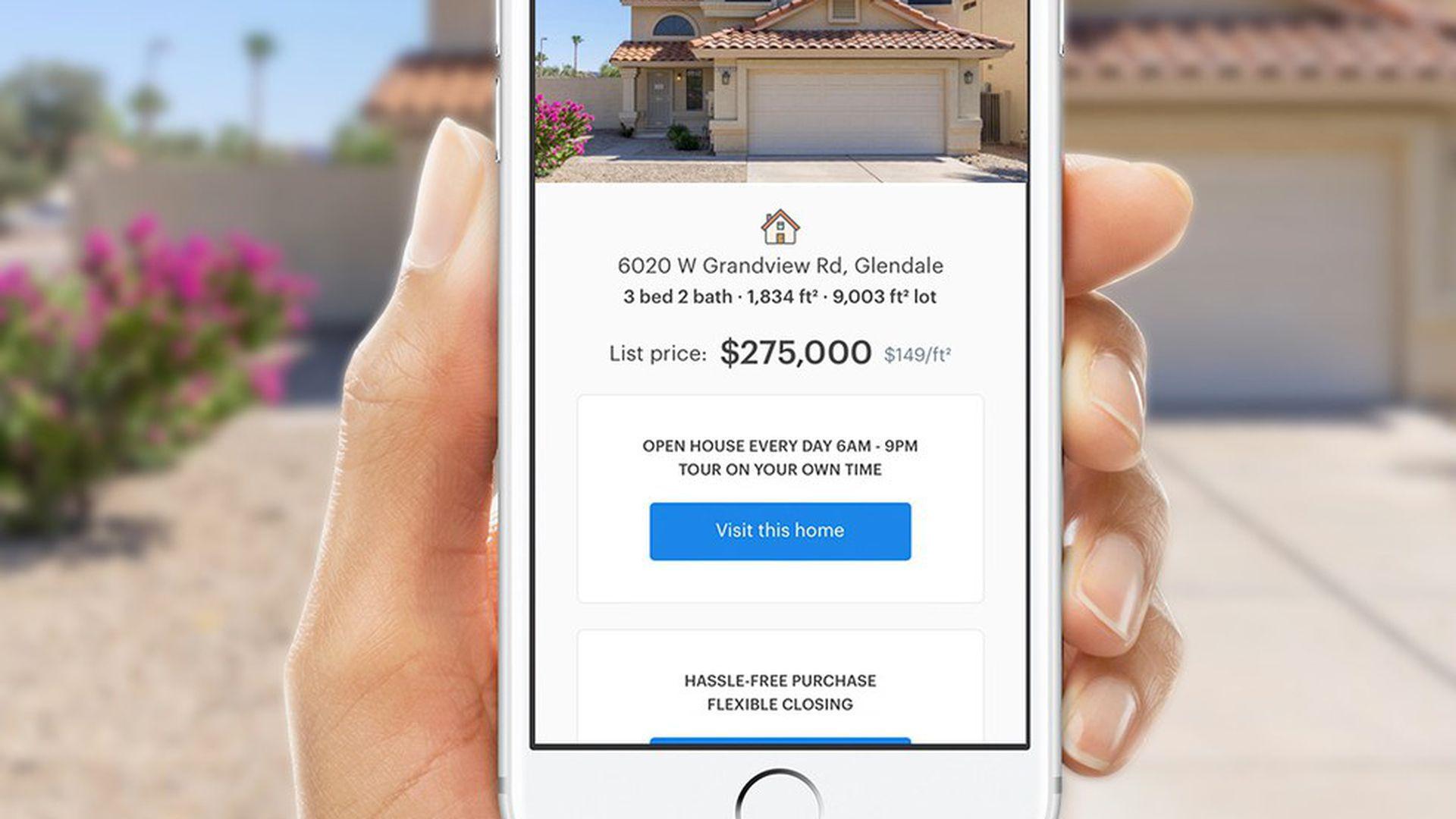 Hand holding Opendoor's home-buying mobile app.