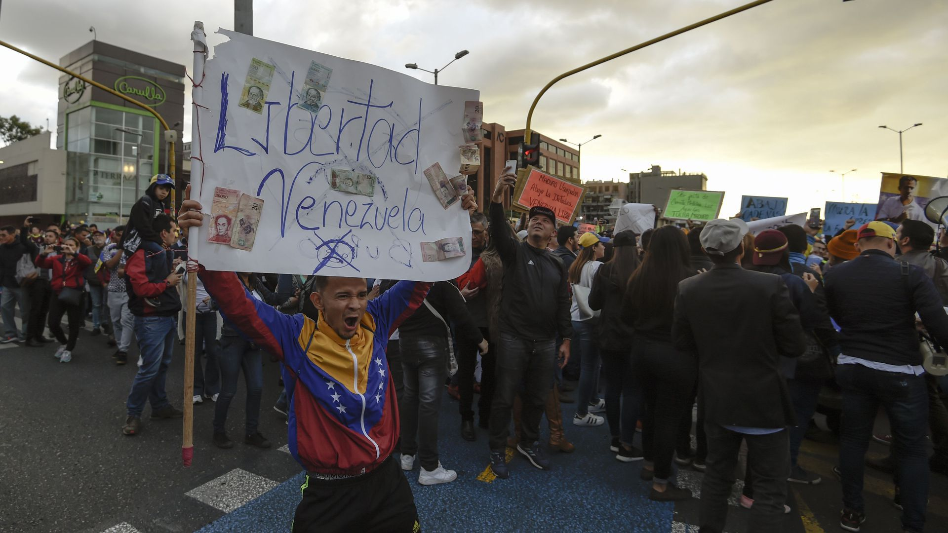 Protestors to President Nicolas Maduro hold demonstration in Bogota, Colombia, on Jan. 23.