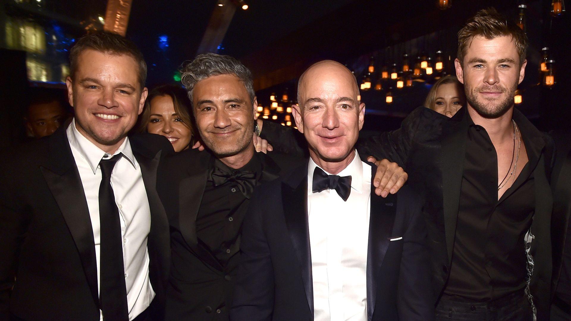 Jeff Bezos surrounded by Matt Damon, Taika Waititi and Chris Hemsworth at a Golden Globes party