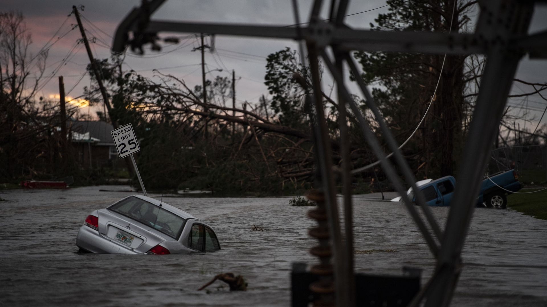 Photo of car submerged in flood waters and electricity pole tilted in Panama City after Hurricane Michael