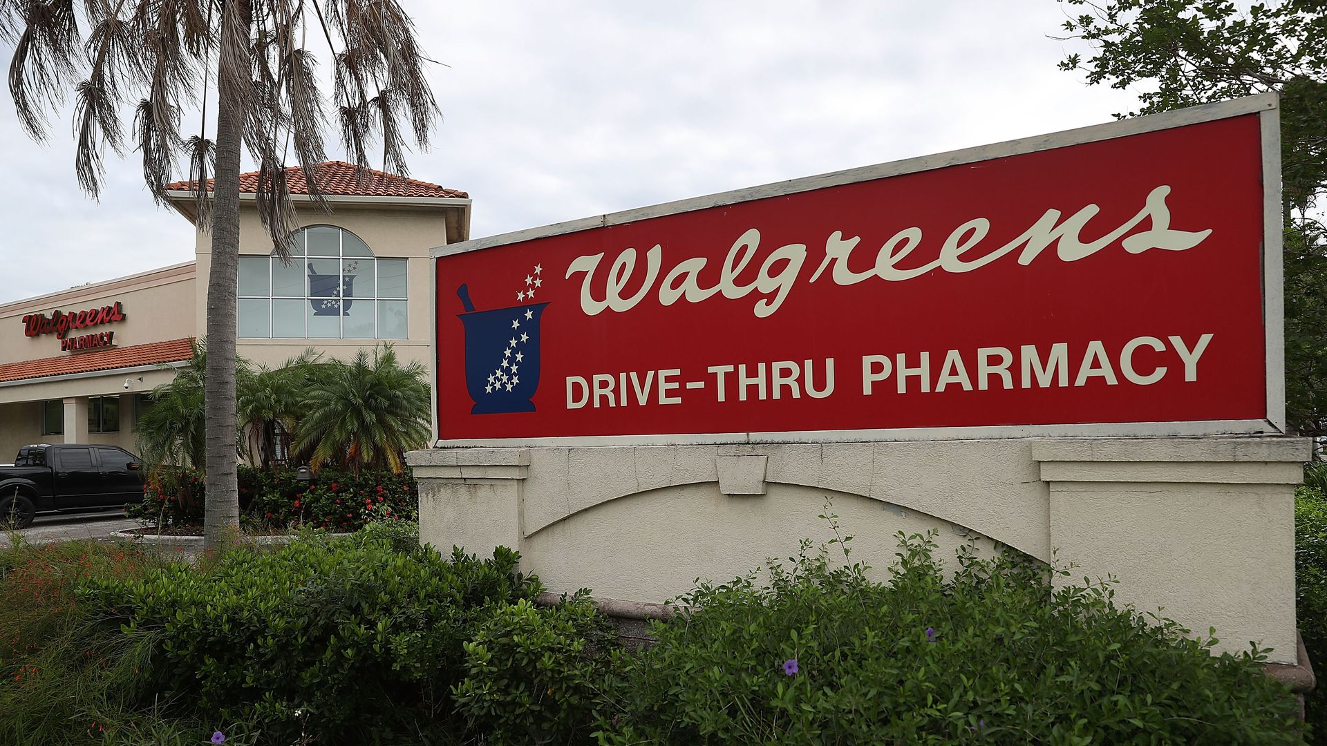 A Walgreens sign in front of the store.