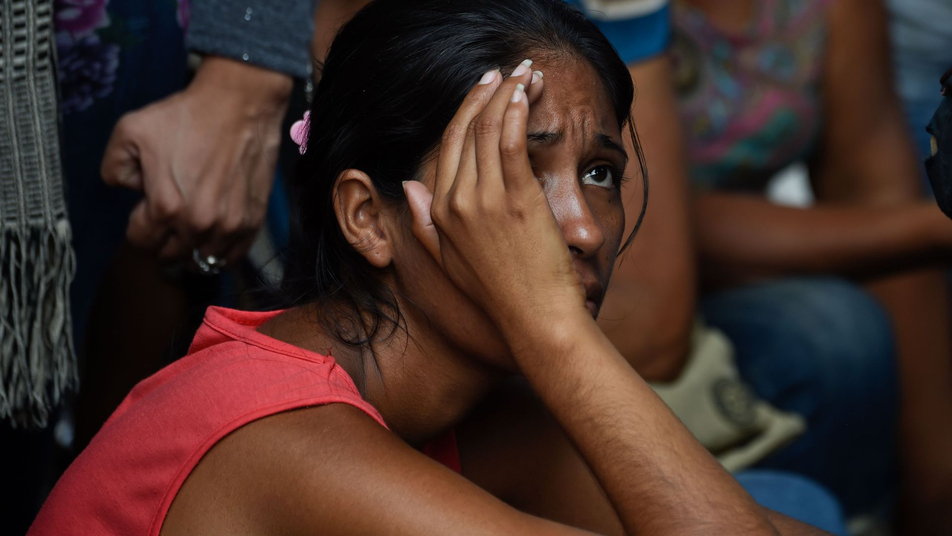 Relatives of prisoners wait outside the police headquarters in Valencia, northern Carabobo state, Venezuela