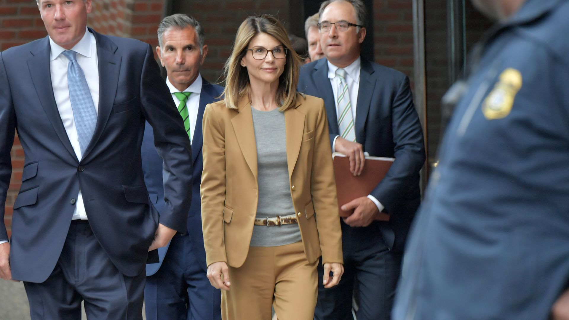 Lori Loughlin exits the John Joseph Moakley U.S. Courthouse after appearing in Federal Court to answer charges stemming from college admissions scandal on April 3, 2019 in Boston, Massachusetts