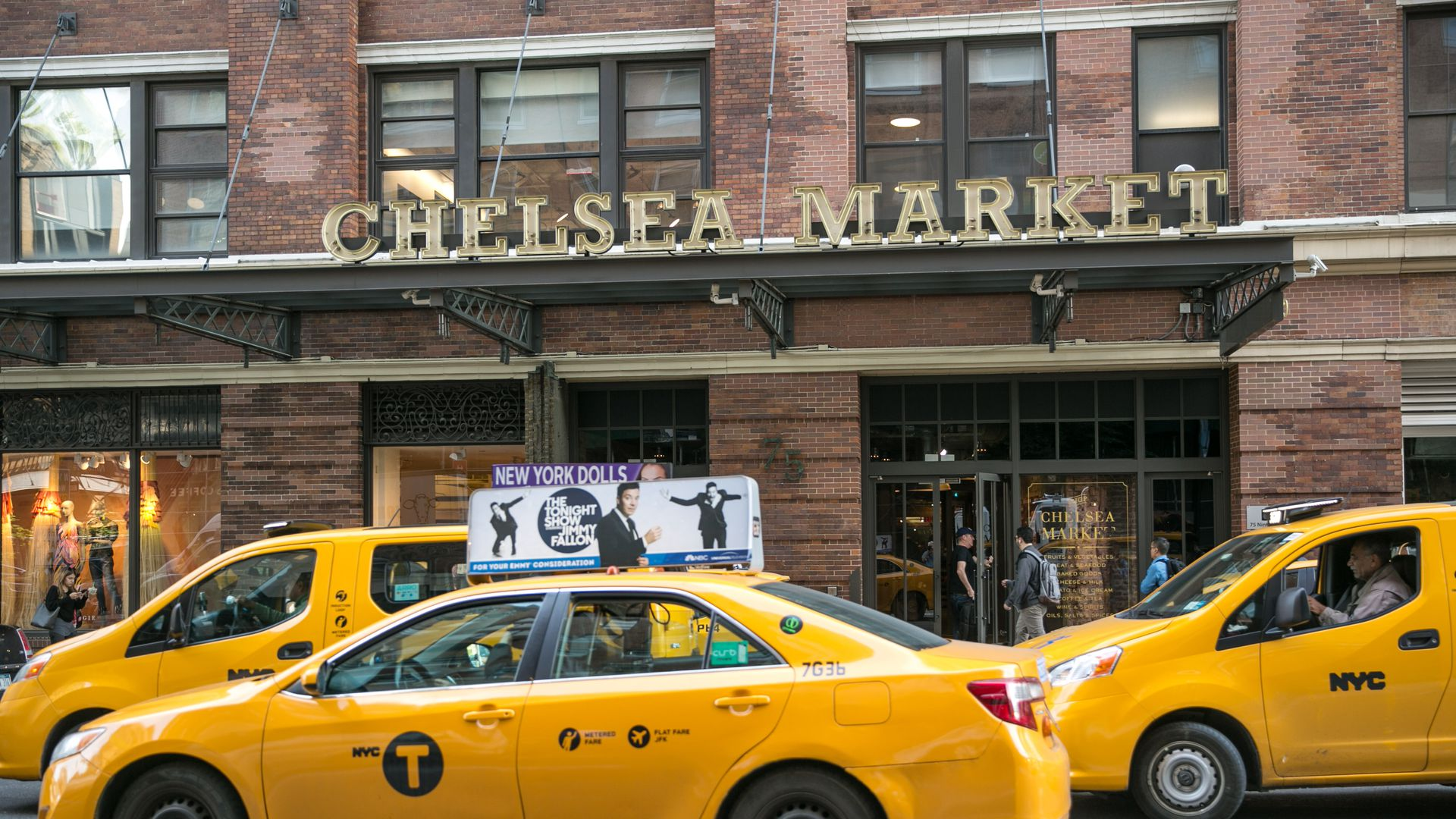 Yellow cabs in front of the entrance to the Chelsea Market building