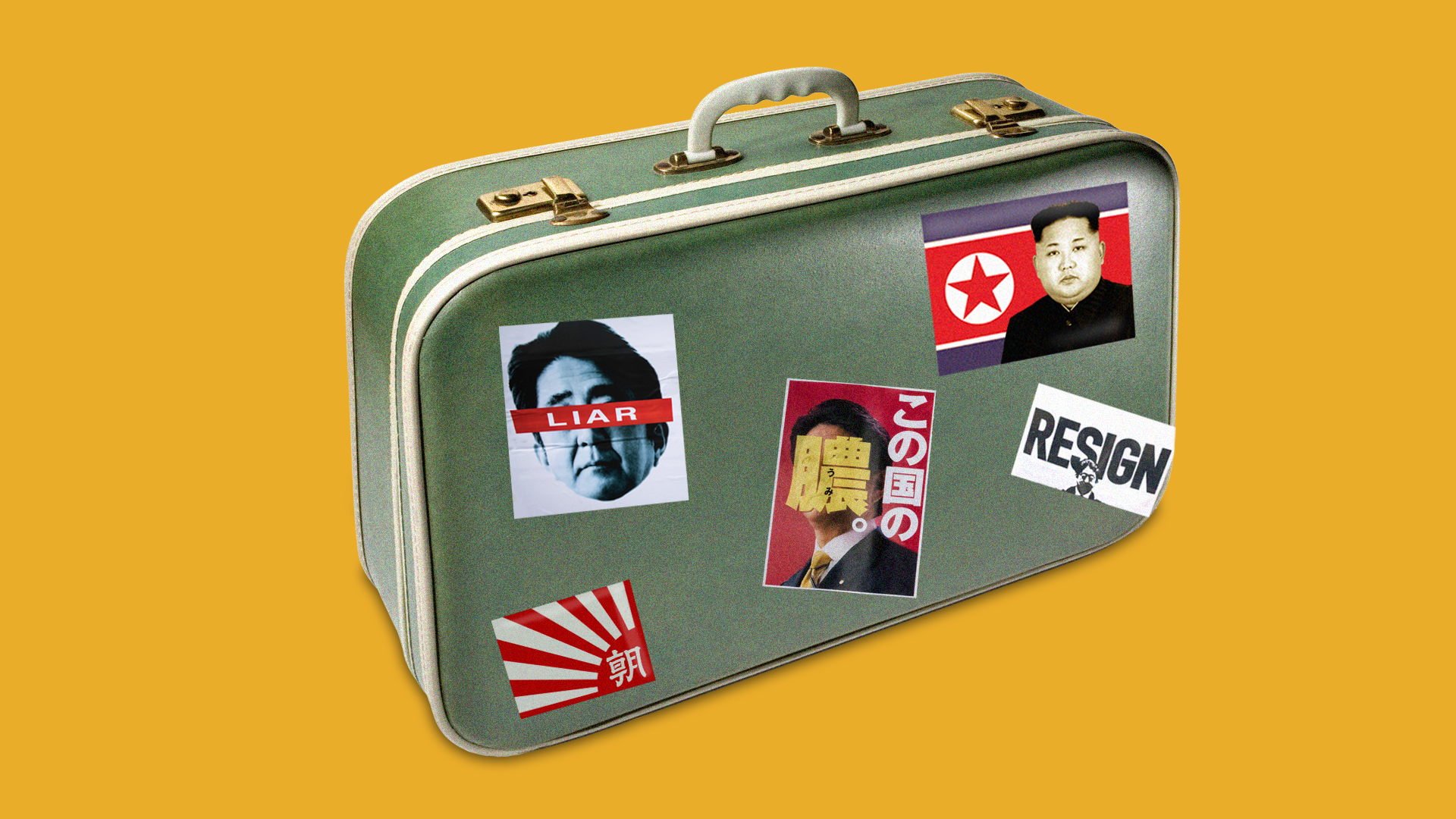 Baggage with vandalized photos of Japanese prime minister