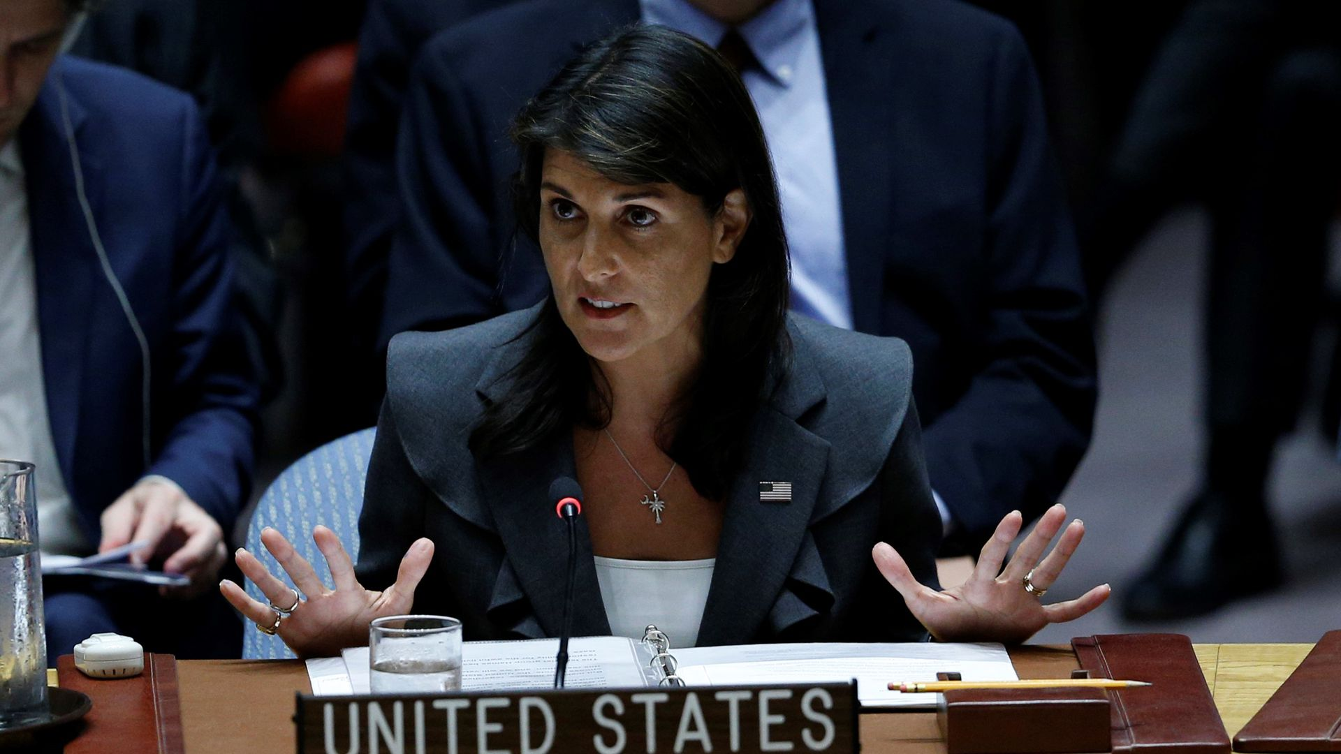 Nikki Haley puts her hands up while speaking behind the United States podium during a U.N. meeting