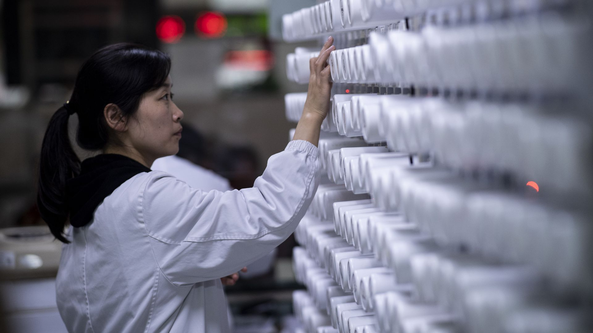 a woman sorting medicine in the pharmacy of the Yueyang Hospital, part of the Shanghai University of Traditional Chinese Medicine