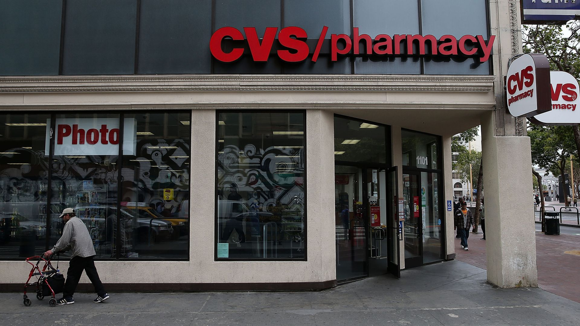 A pedestrian walks by a CVS store.