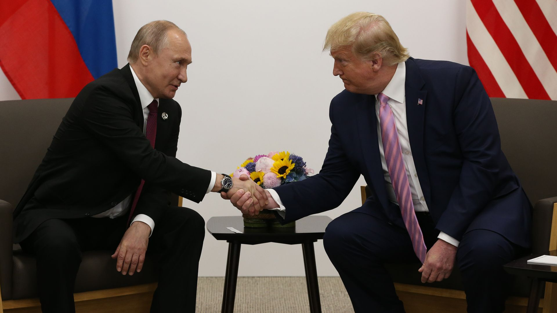 President Trump and Russian President Vladimir Putin shaking hands at the G20 Summit in Japan