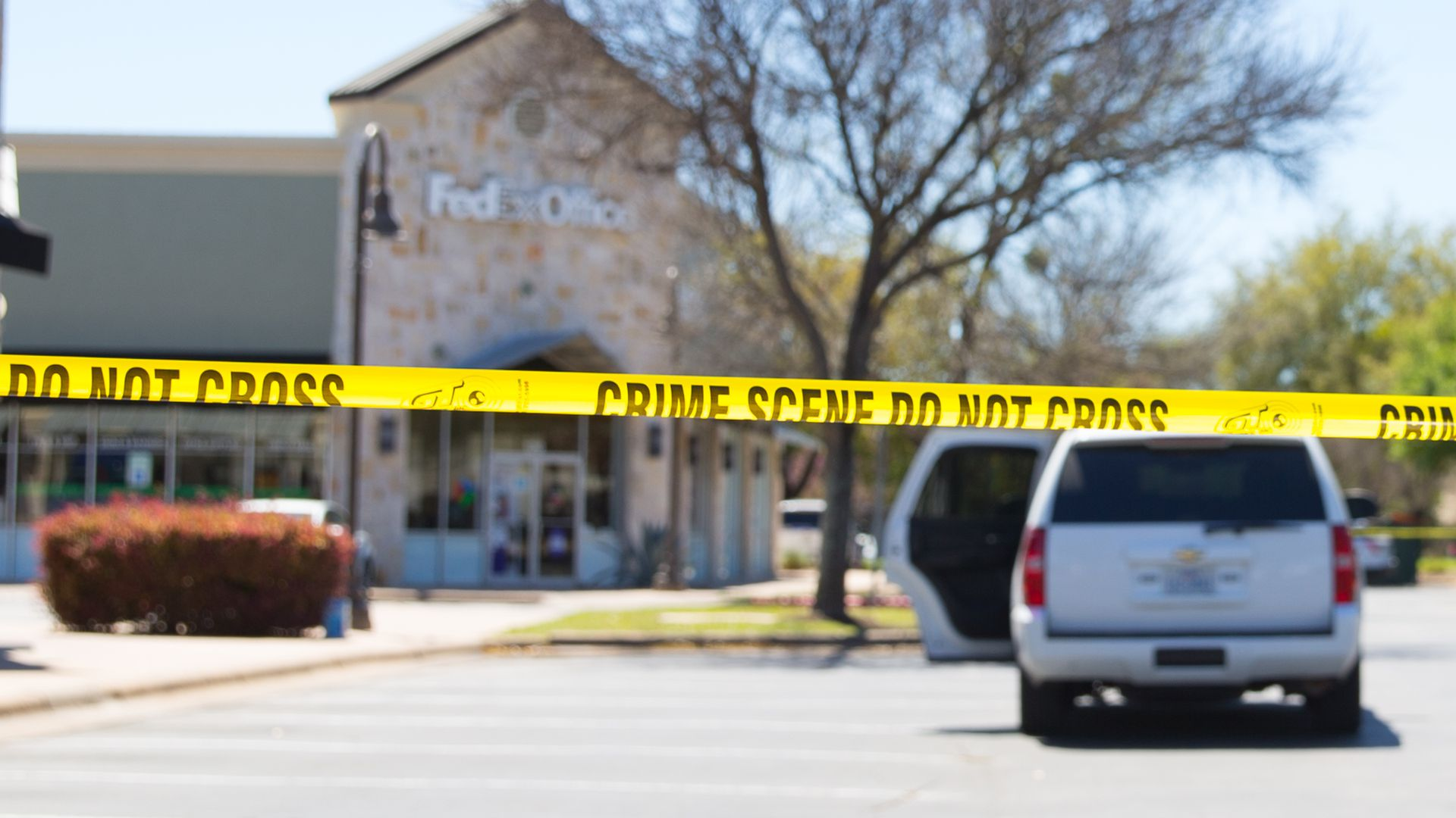 Police and FBI Agents investigate at the Sunset Valley FedEx store in Austin, Texas, which is linked to the package bomb.