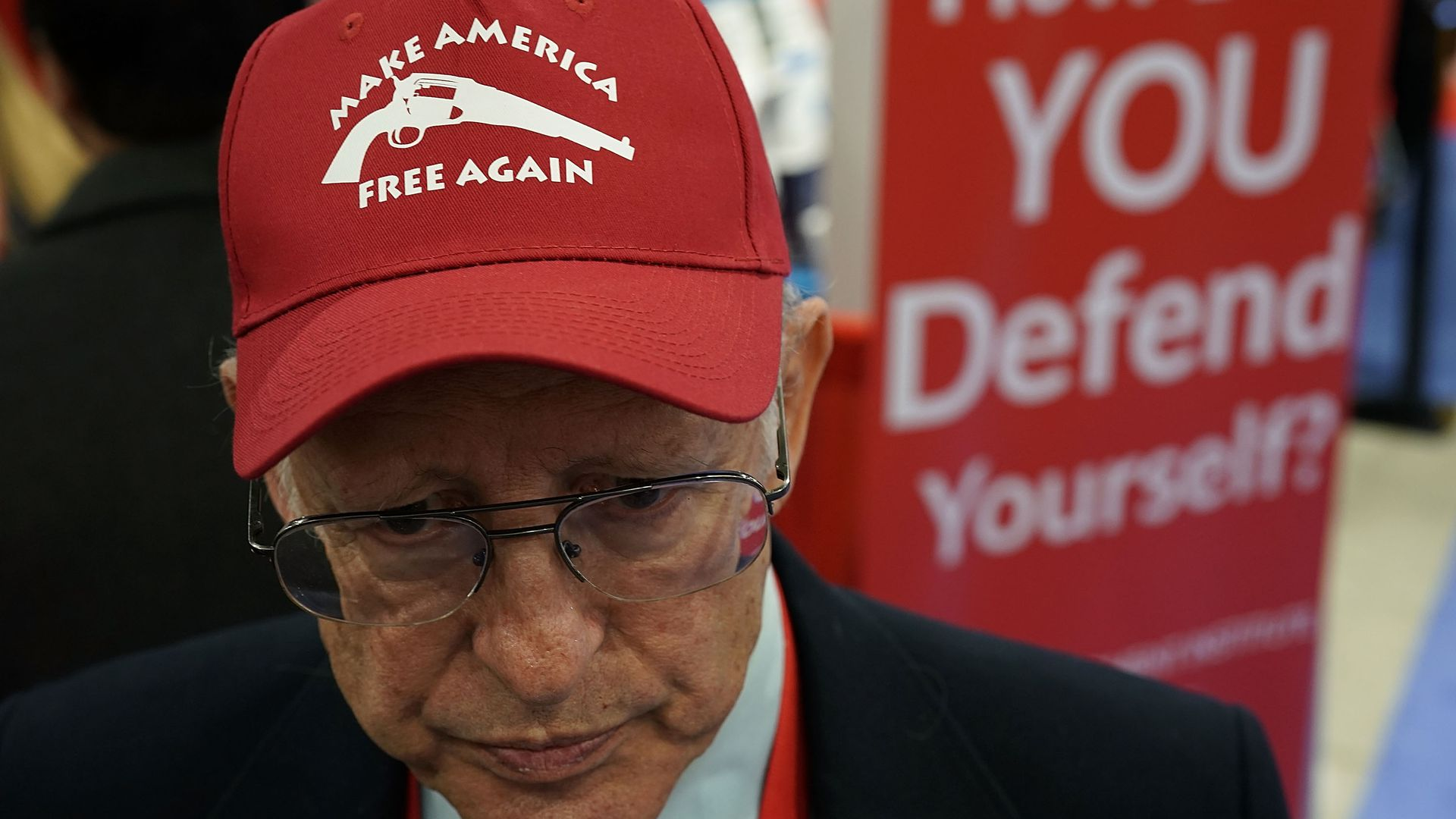 "Dick Heller wearing a hat that says ""Make America Free Again."""