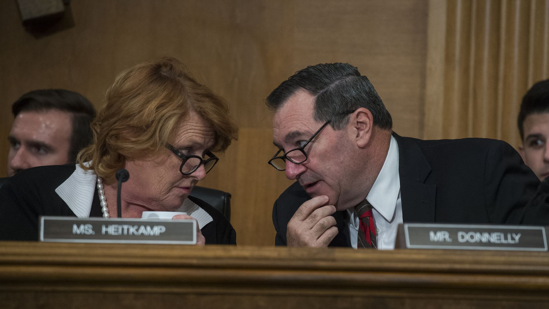 Heidi Heitkamp and Joe Donnelly talking