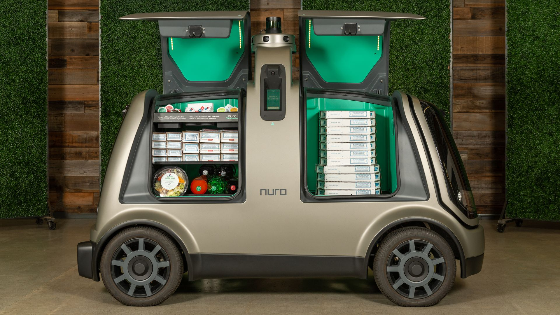 Nuro self driving vehicle with Domino's pizzas in it