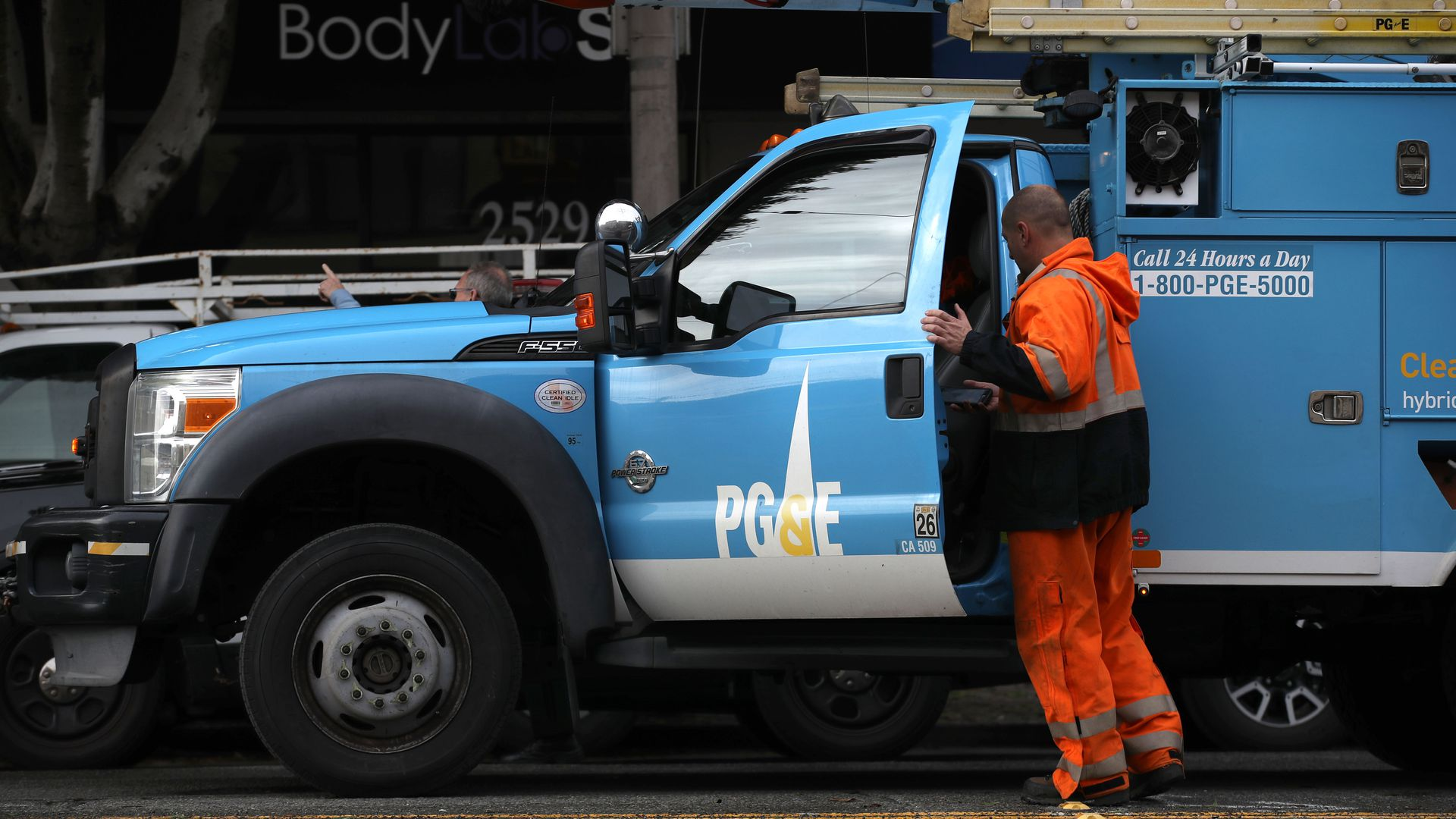 A worker getting into his PG&E truck