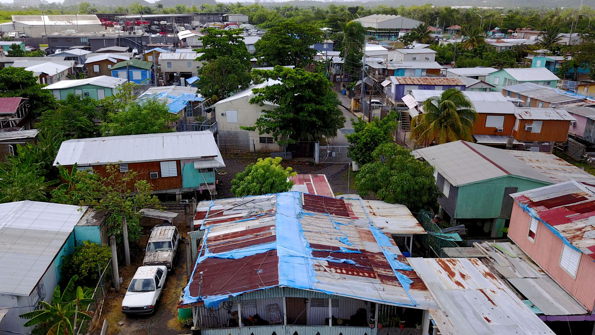 The blue tarp that was used to protect the roof damaged by Hurricane Maria two years ago is showing wear and tear in San Juan, Puerto Rico, September 18