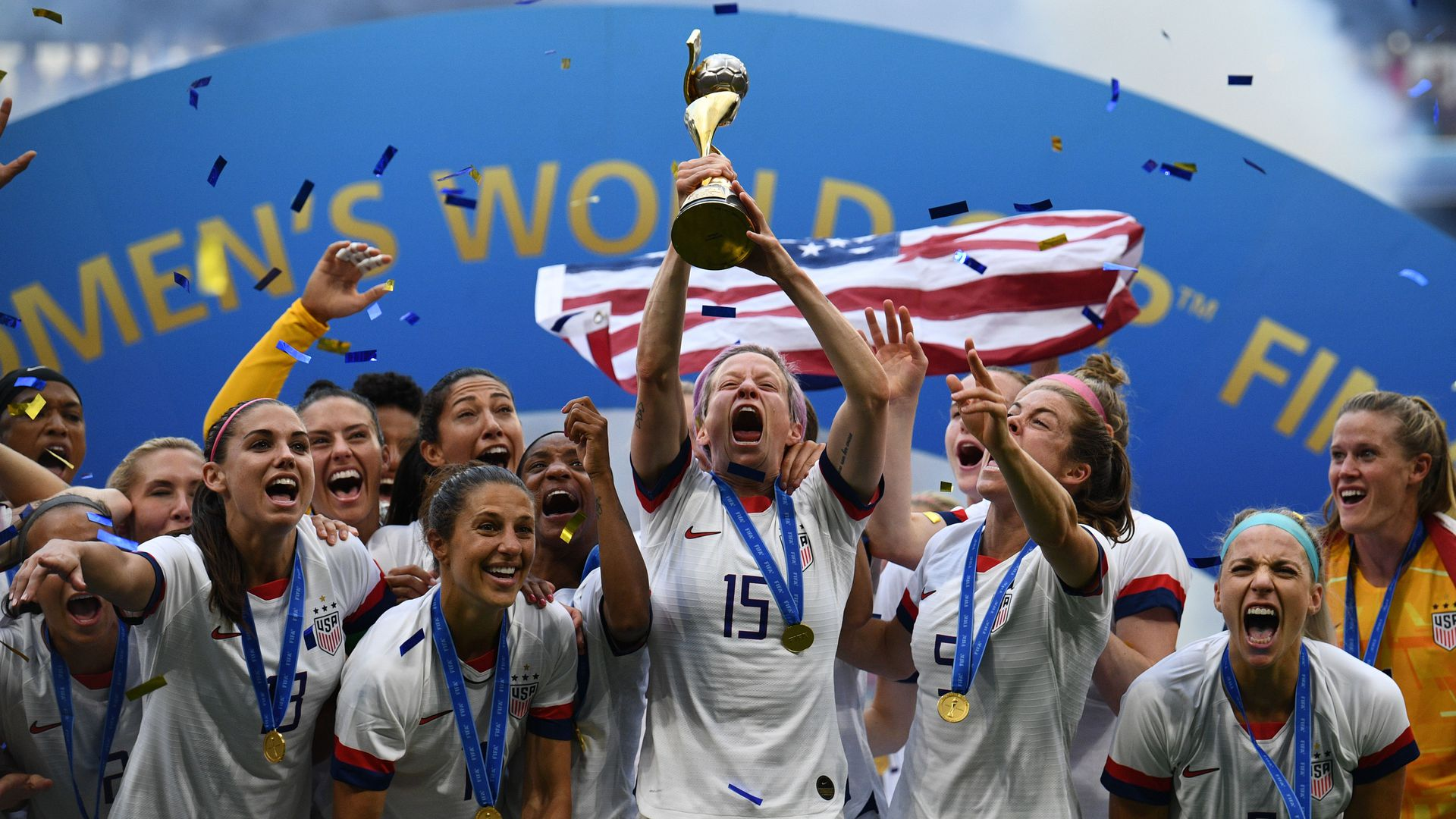 USA's players including forward Megan Rapinoe (C) celebrate with the trophy after the France 2019 Womens World Cup football final match between USA and the Netherlands, on July 7