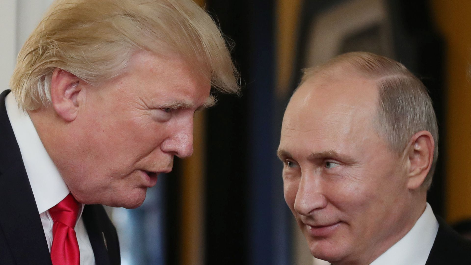 Donald Trump speaks to Vladimir Putin at close proximity.