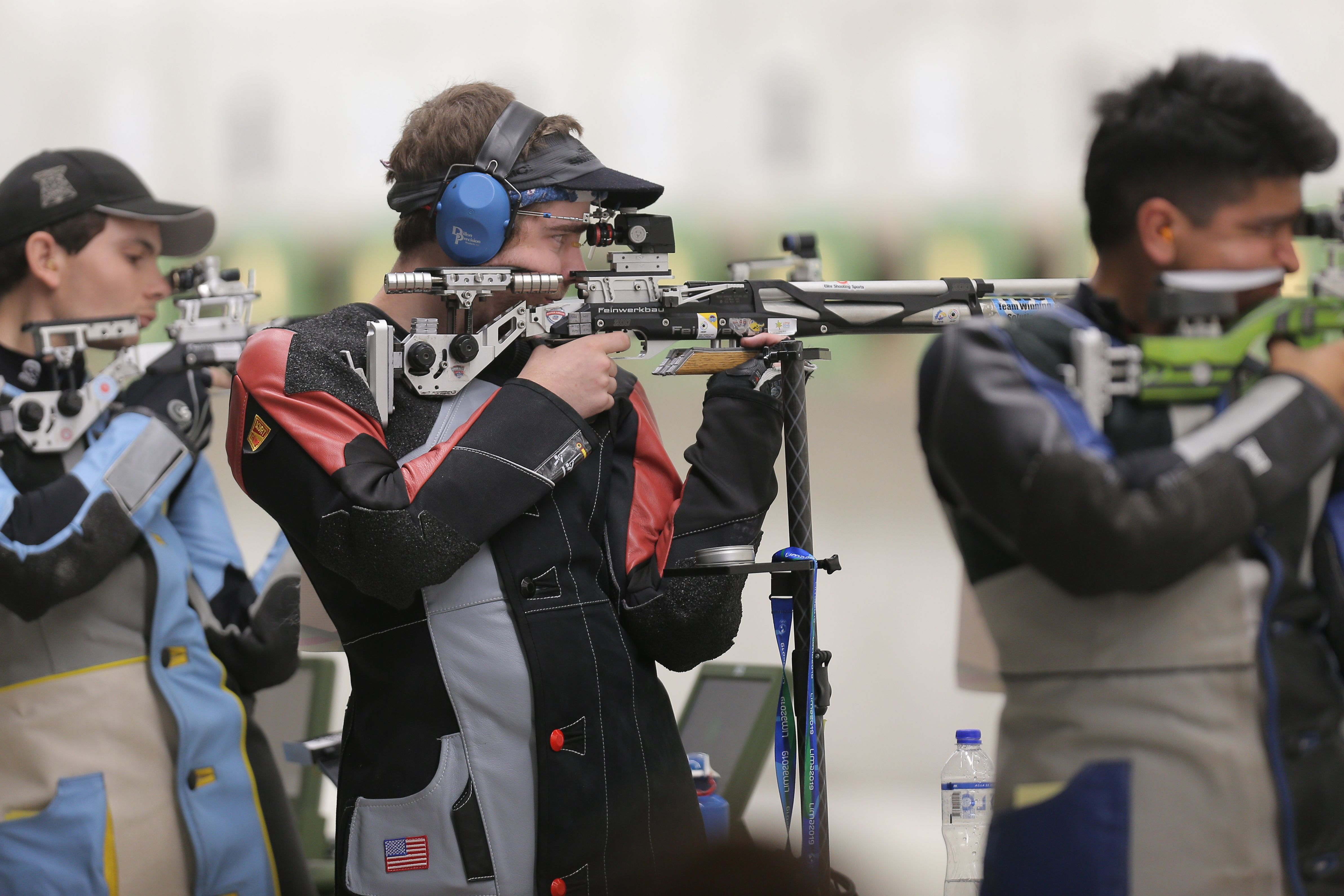Lucas Kozeniesky, center, competes in the Men's 10m Air Rifle shooting competition during the Lima 2019 Pan-American Games.