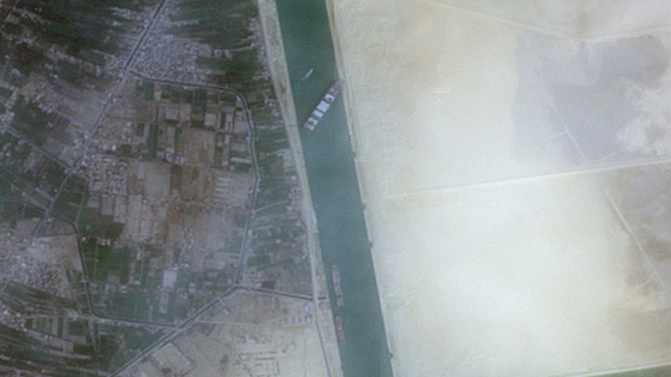 Rescuers say skyscraper-sized ship stuck in Suez Canal could take weeks to unblock thumbnail
