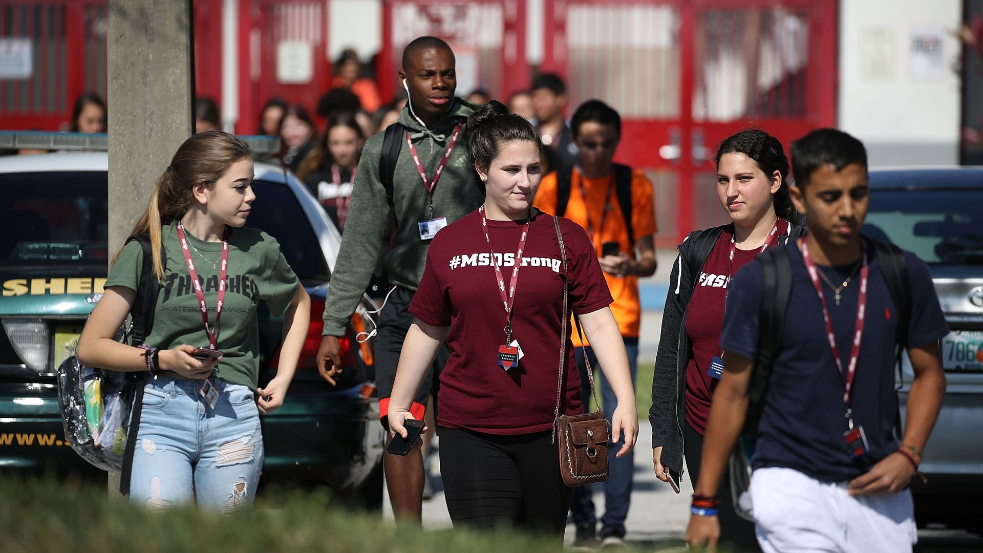 Students walk out from Stoneman high school