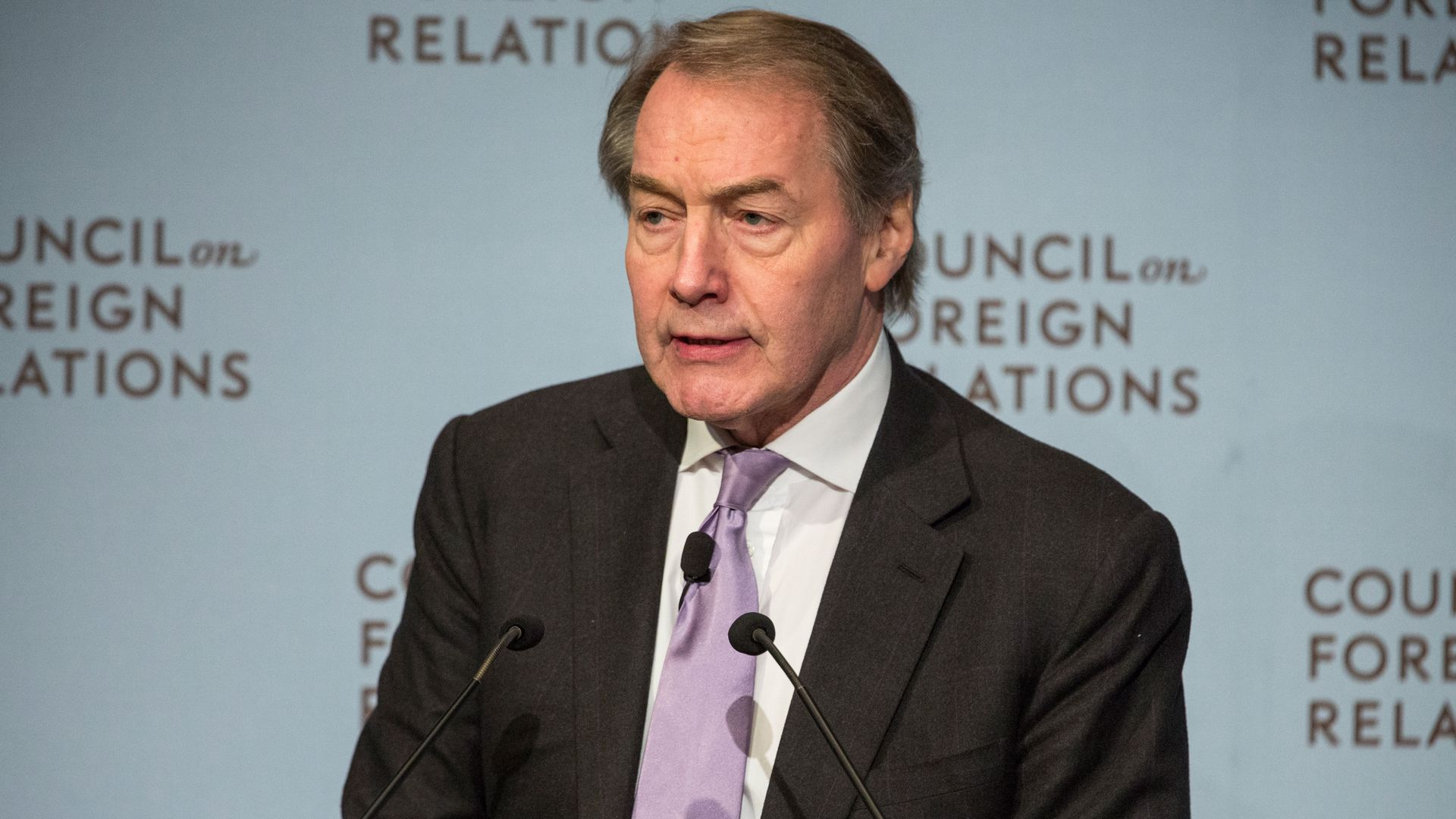 Journalist Charlie Rose standing at a podium from 2015
