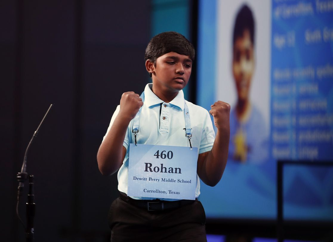 Rohan Raja, 12, puts up his fists triumphantly