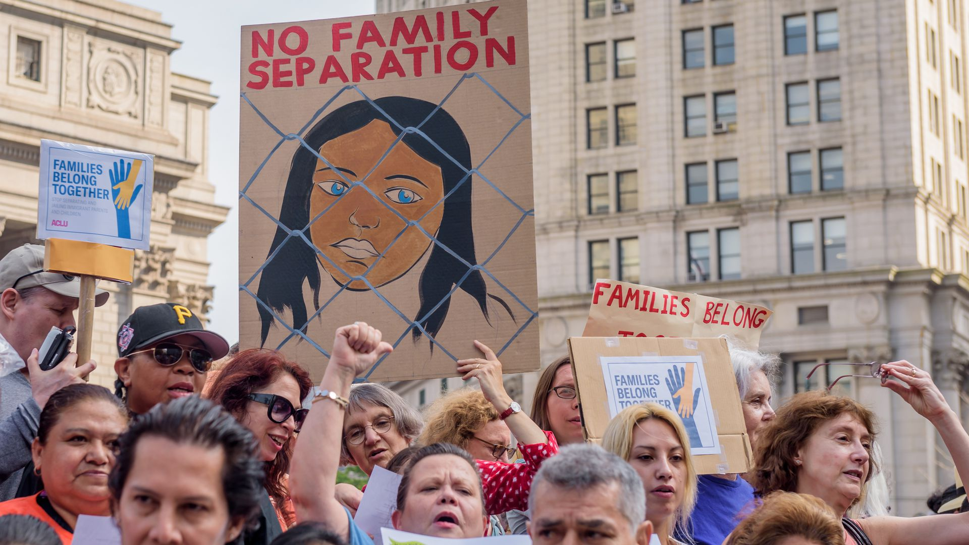 "Protests against the separation of family immigrants. People holding signs that say ""no family separation"""
