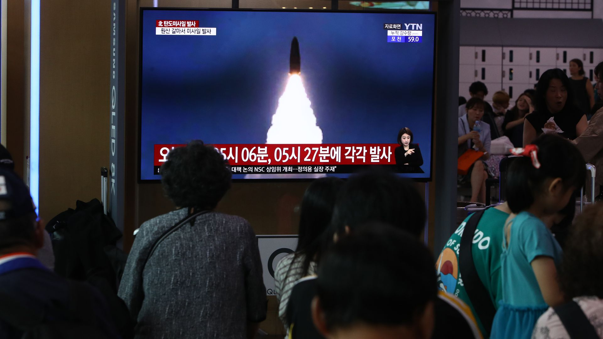 North Koreans watching missile test