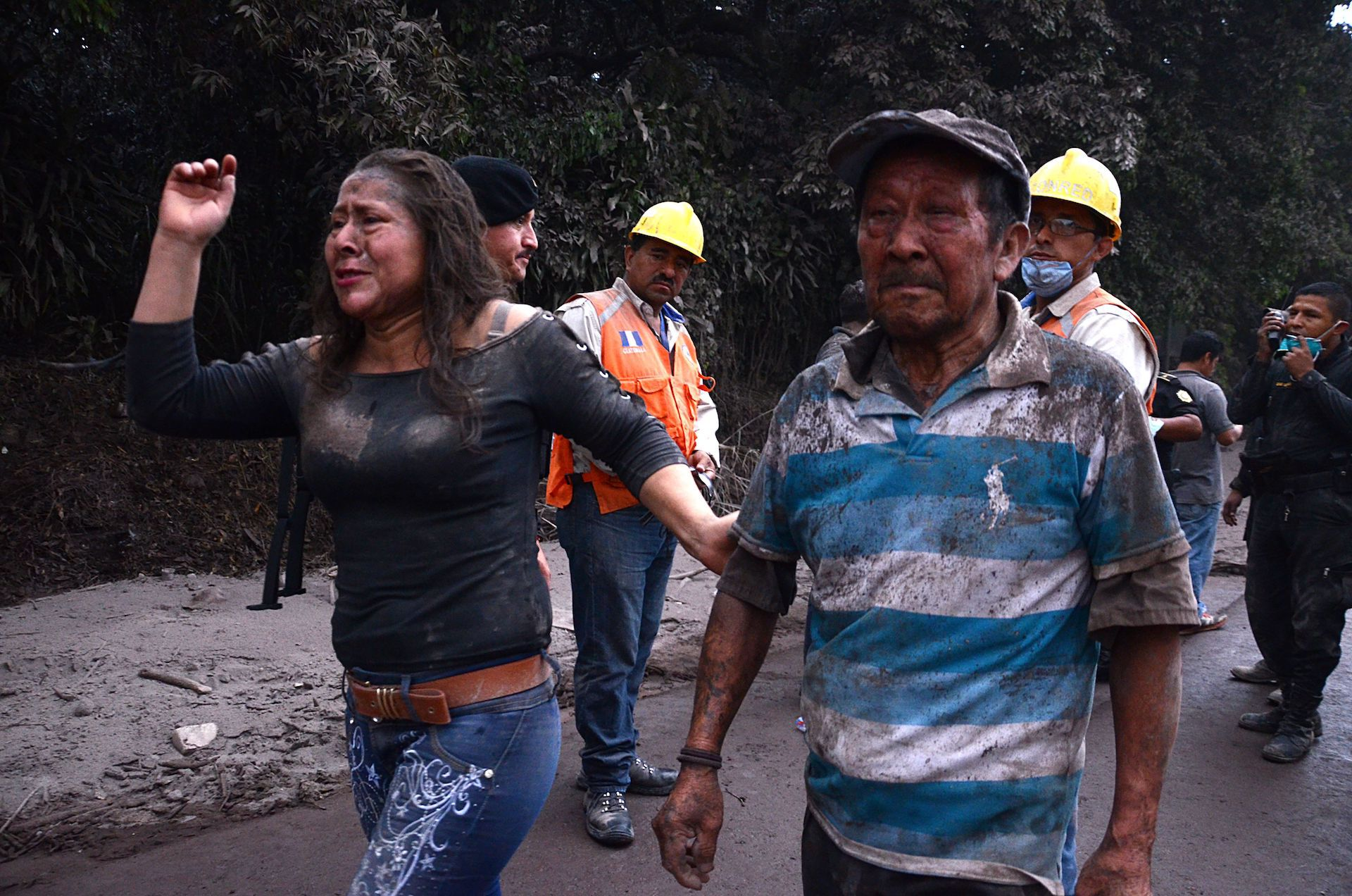 People flee El Rodeo village after the Fuego volcano eruption on June 3, 2018.