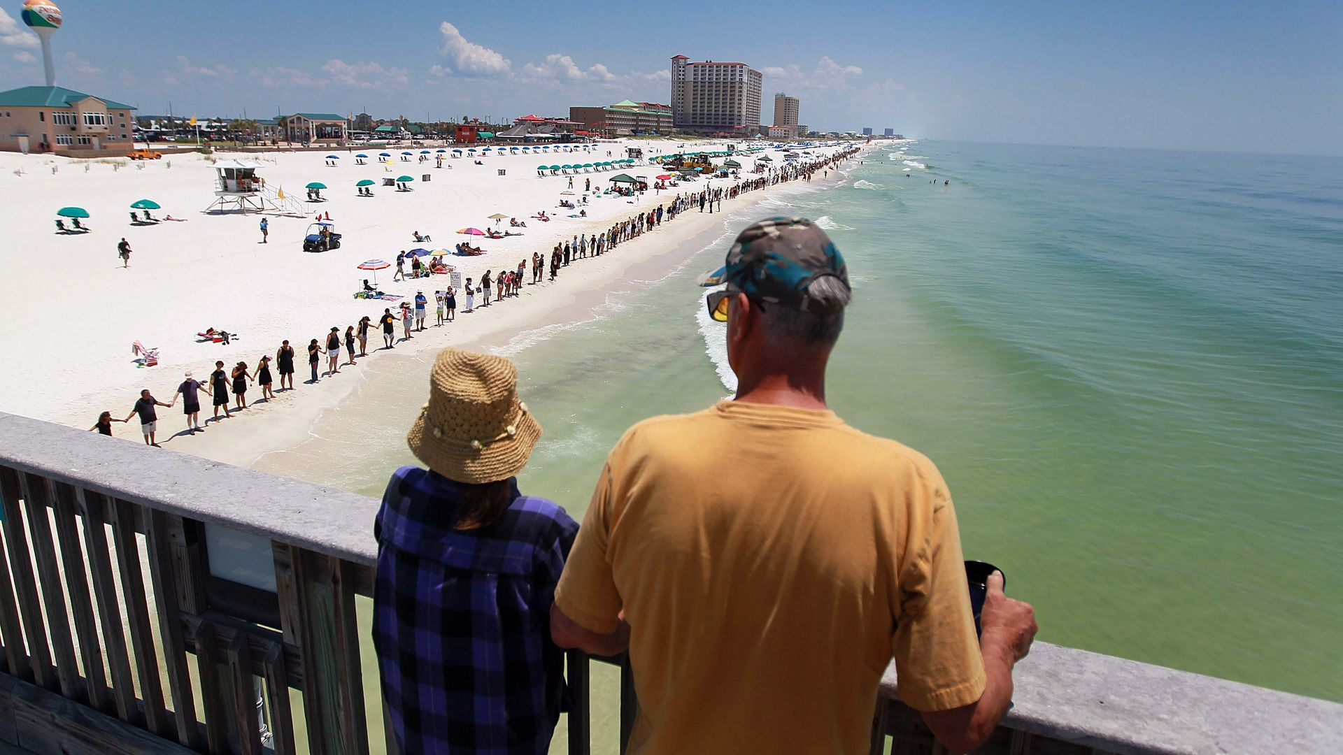 Line of people stretches across Pensacola beach in the June 2010 Hands Across the Sand protest against the Deepwater Horizon oil spill