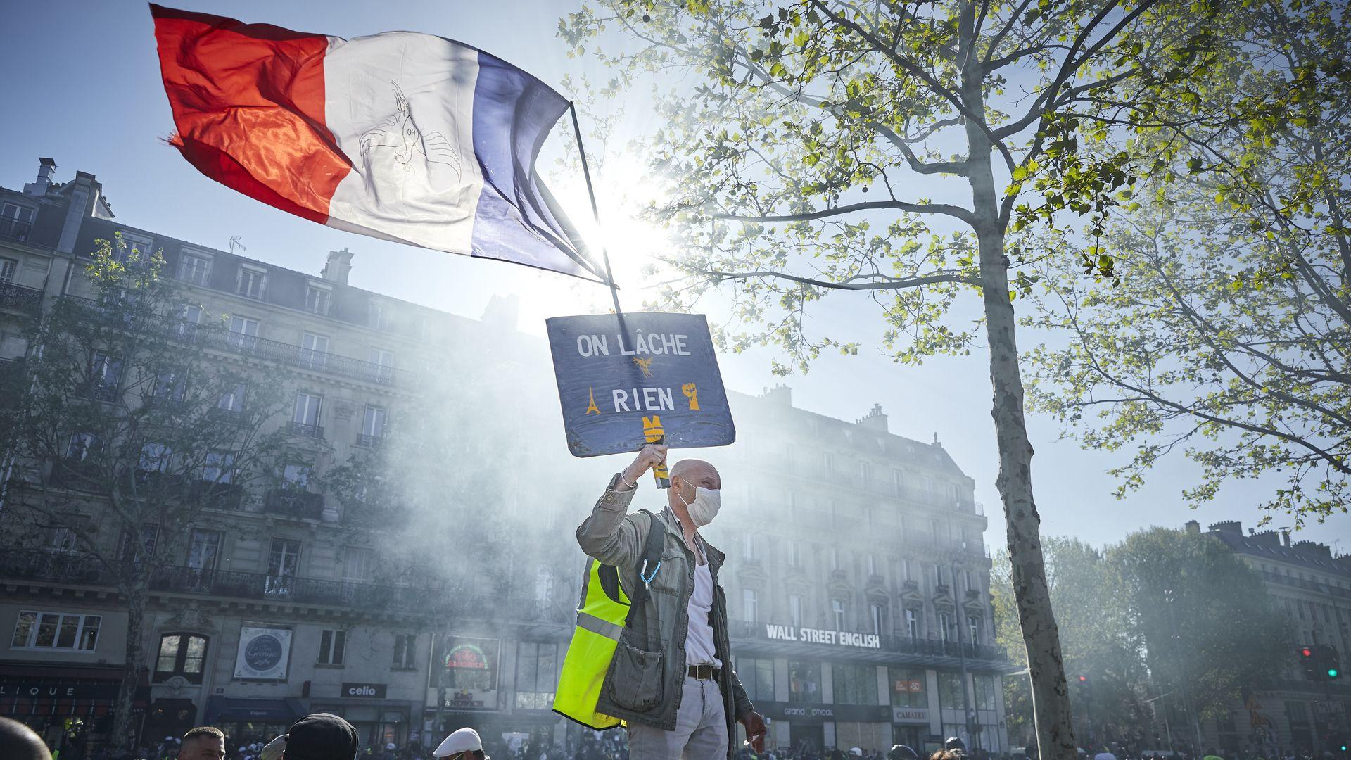 Man protesting in Paris against economic inequality