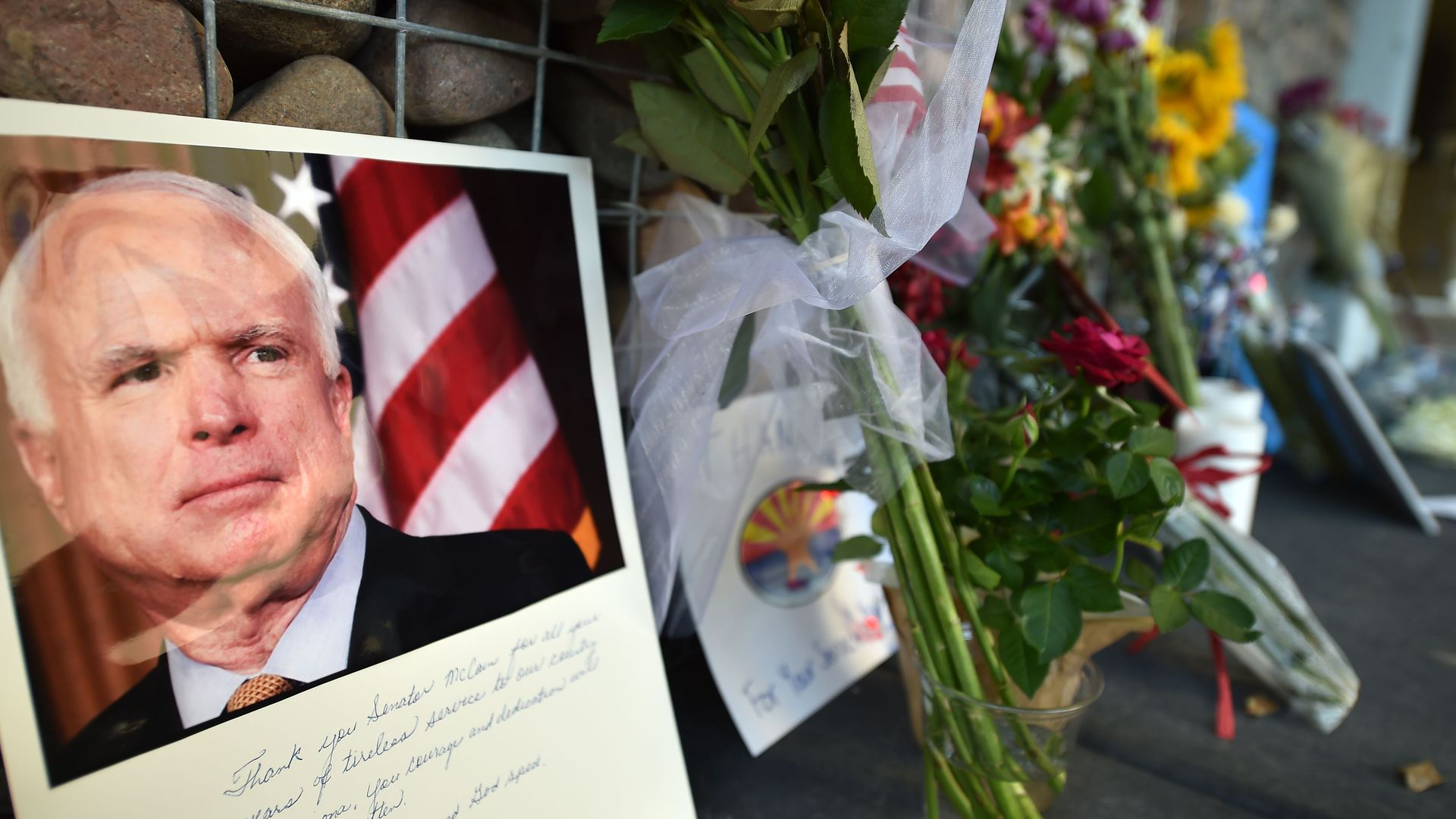 A makeshift memorial to Sen. John McCain outside his office in Phoenix, Arizona. Photo: Robyn Beck/AFP/Getty Images