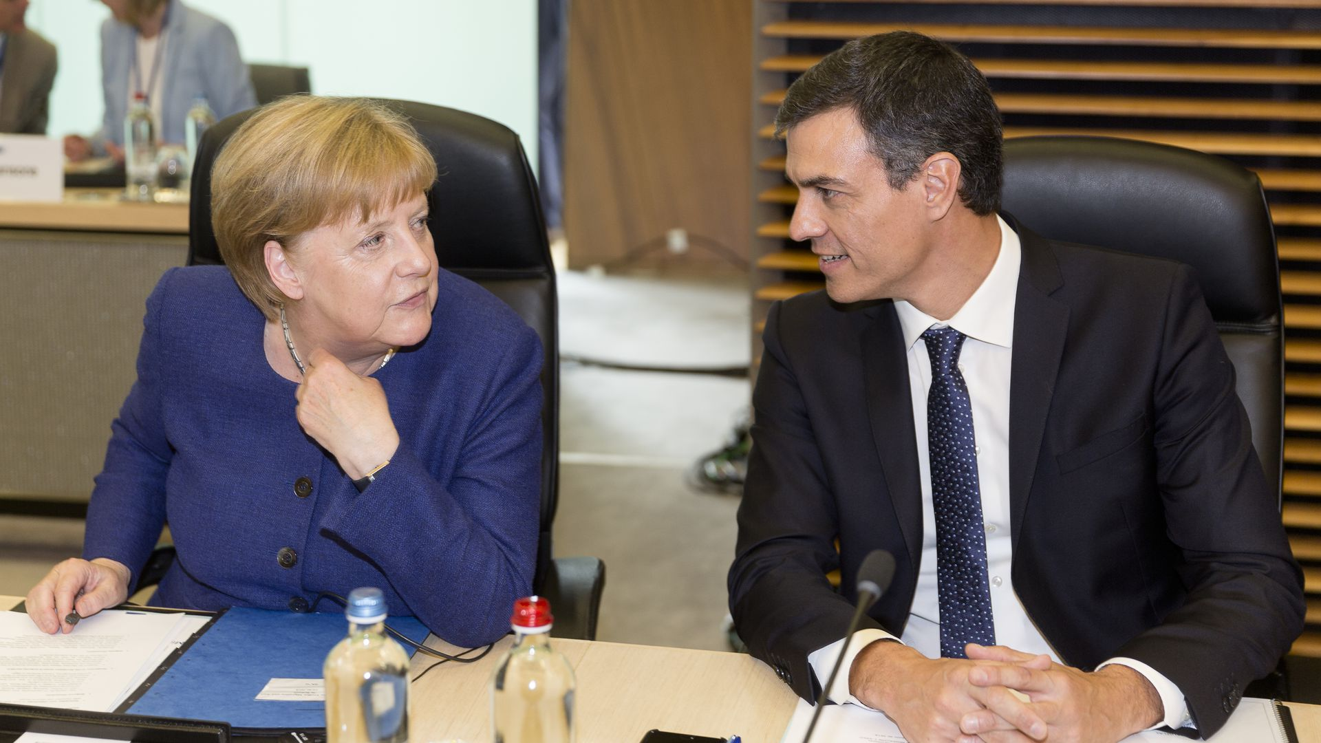 German Chancellor Angela Merke talks with Spanish Prime Minister Pedro Sanchez before a meeting on migration and asylum issues on June 24, 2018 in Brussels, Belgium.