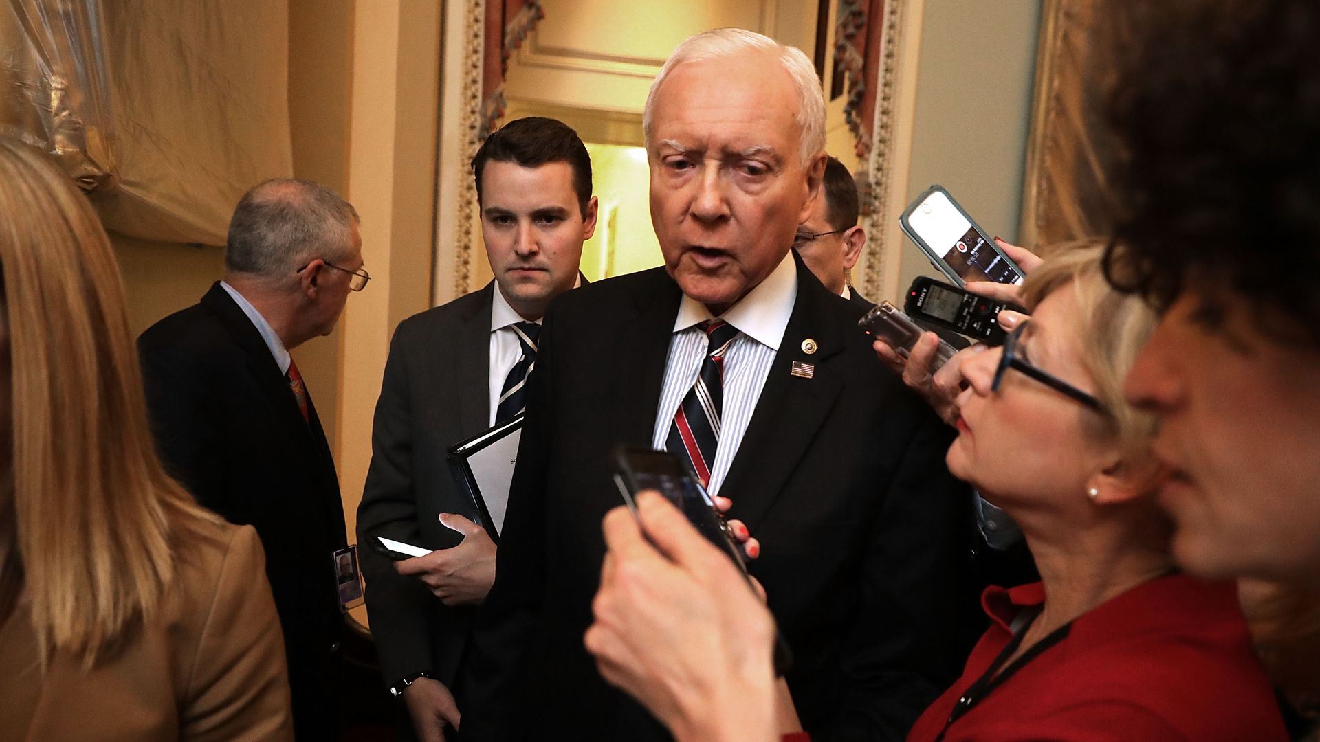 Orrin Hatch talks to reporters