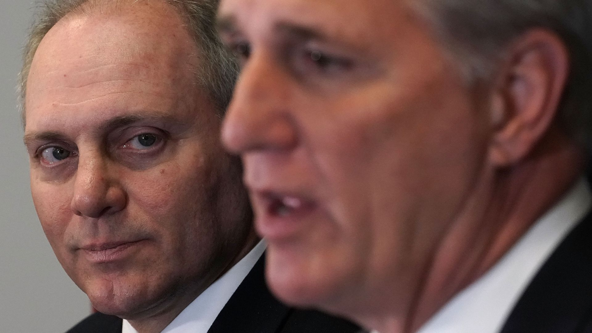 Rep. Steve Scalise in focus looking past Rep. Kevin McCarthy who is out of focus.
