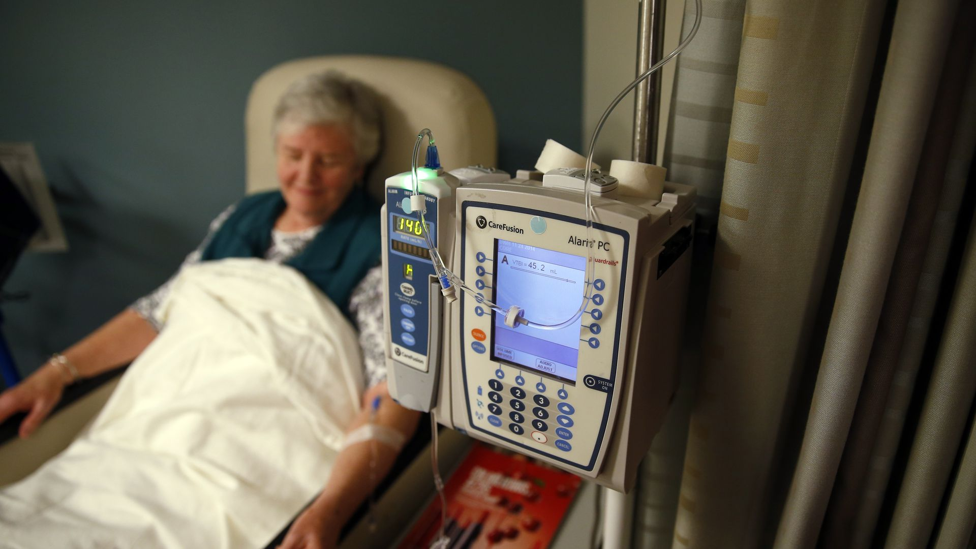 A patient gets her medication intravenously at a hospital.