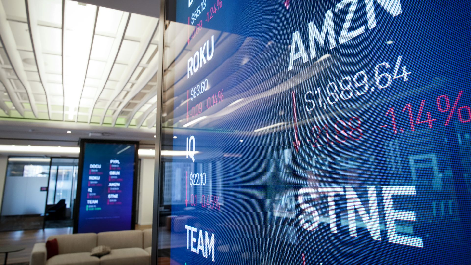 MAY 2: Stock information about Amazon is displayed on a monitor inside Nasdaq's new 'Client Experience Center' at their office in Times Square.