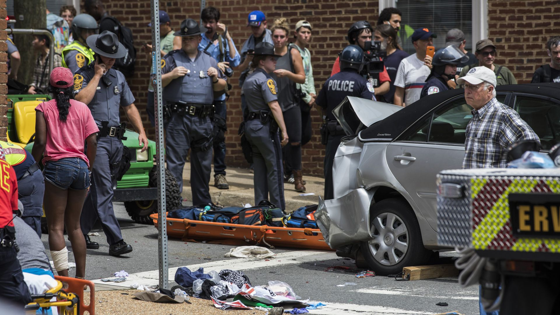 First responders and protestors attend to the injured people after a car rammed into a crowd of anti-White Supremacy protestors in Charlottesville in August  2017.
