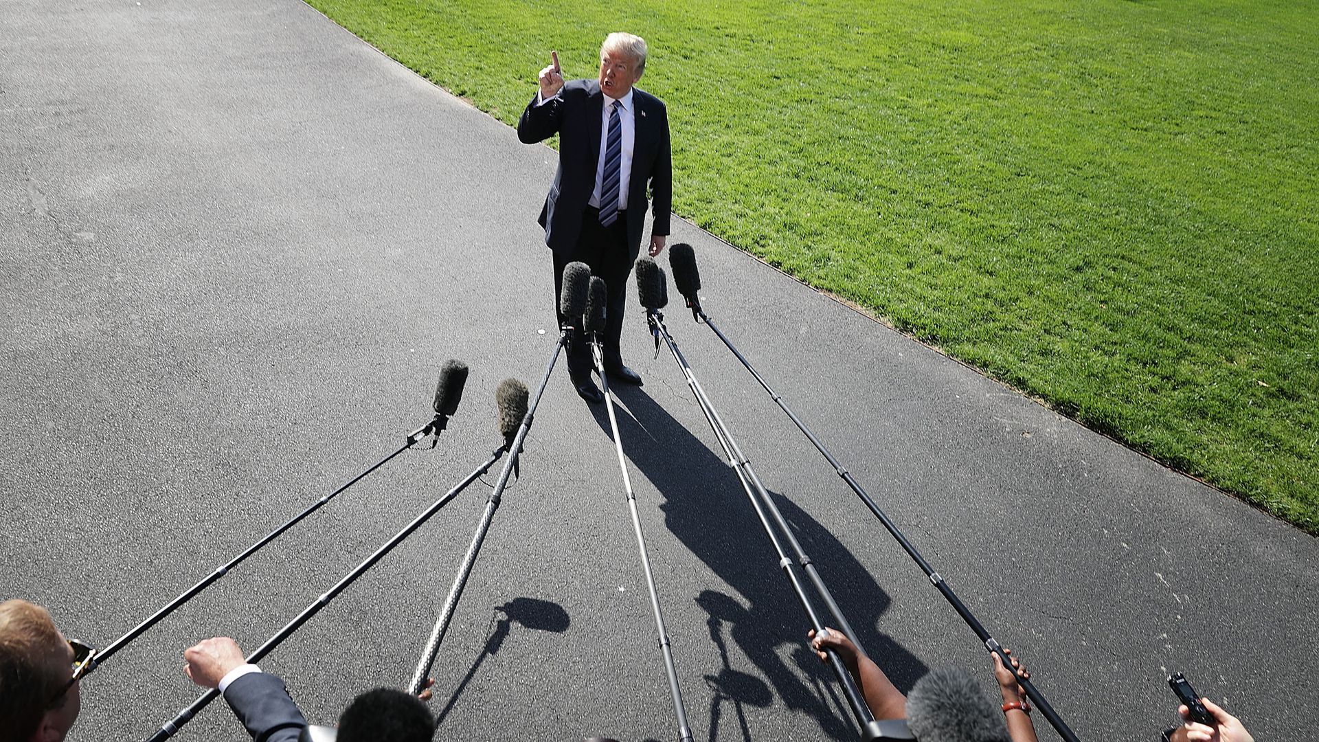 President Trump with his finger in the air talking to reporters