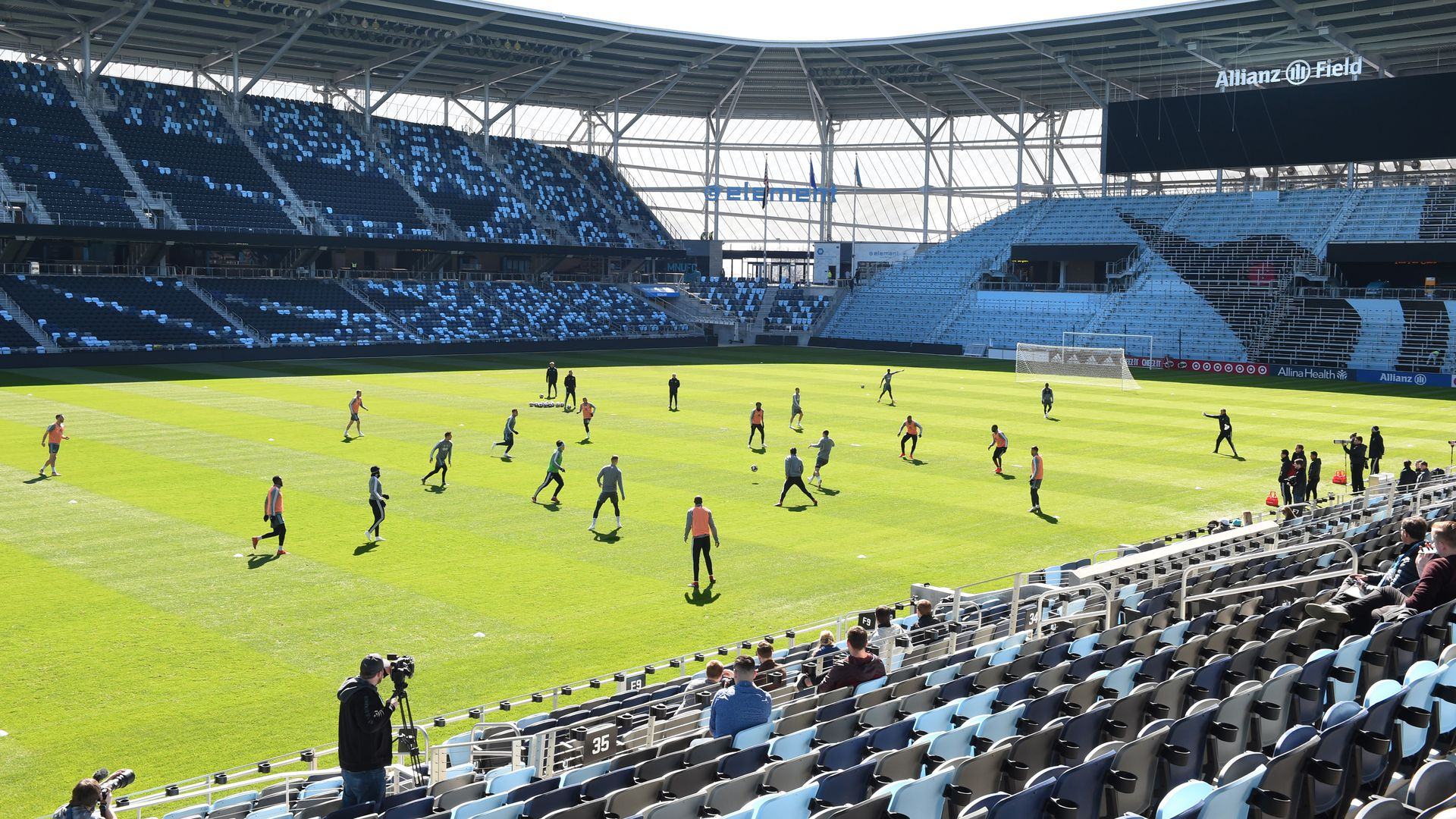 The Allianz field soccer pitch with players on green grass