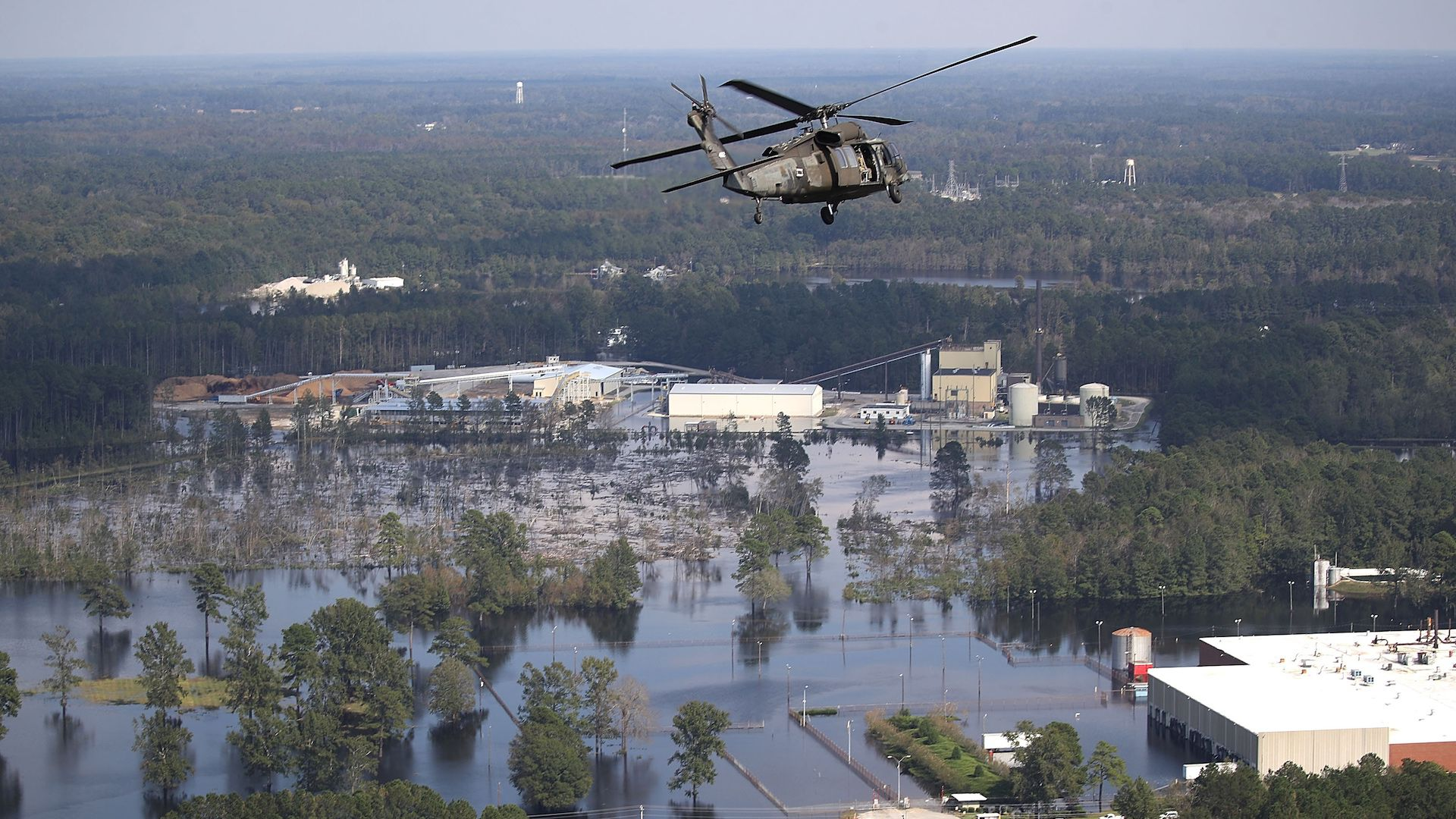 Hurricane Florence flooding: A U.S. Army helicopter flies over homes and businesses flooded by heavy rains from Hurricane Florence on September 20, 2018 in Lumberton, North Carolina.