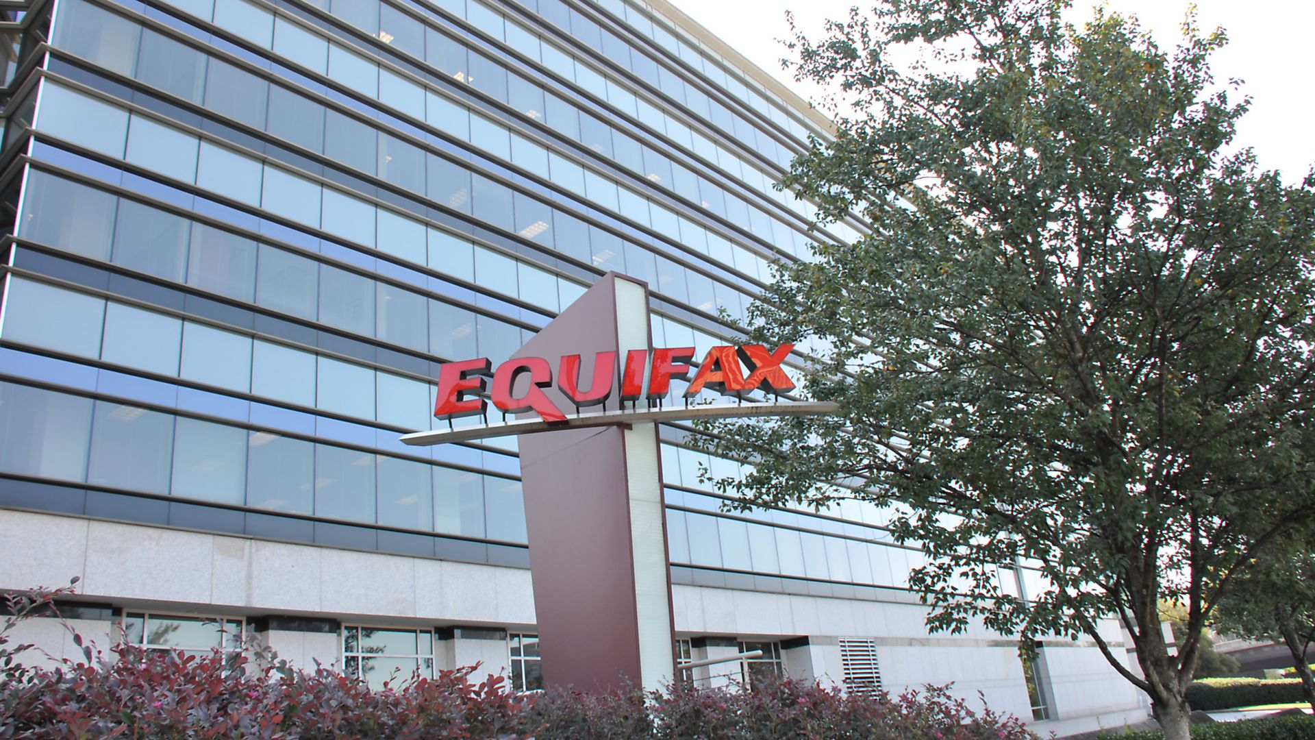 Sign with logo and a portion of the main building are visible at the headquarters of credit bureau Equifax in downtown Atlanta, Georgia. (Photo via Smith Collection/Gado/Getty Images)