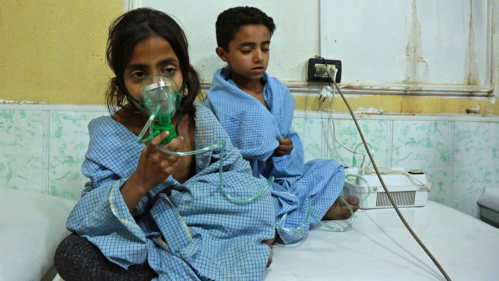 Two Syrian children apparently suffering from nerve gas attack in a clinic