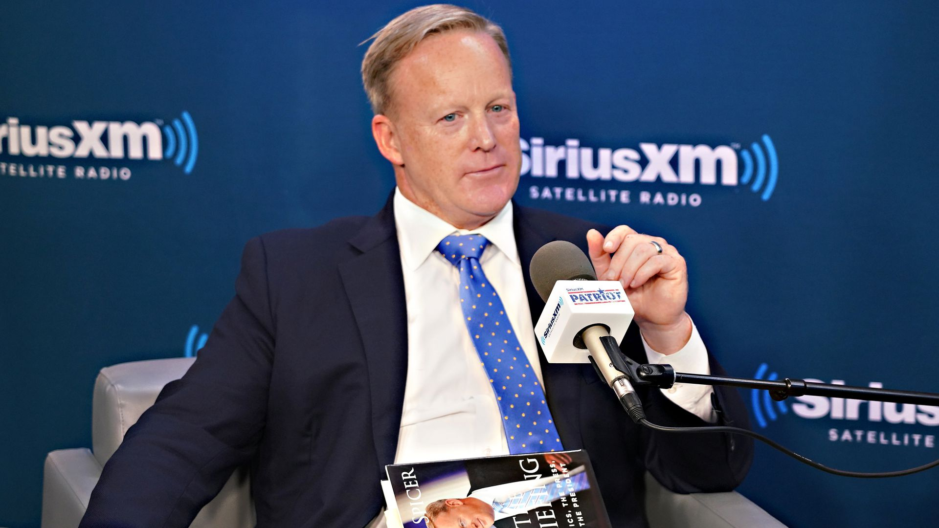 Sean Spicer talks to host David Webb during a SiriusXM Patriot Forum at the SiriusXM Studios on July 23, 2018 in New York City.