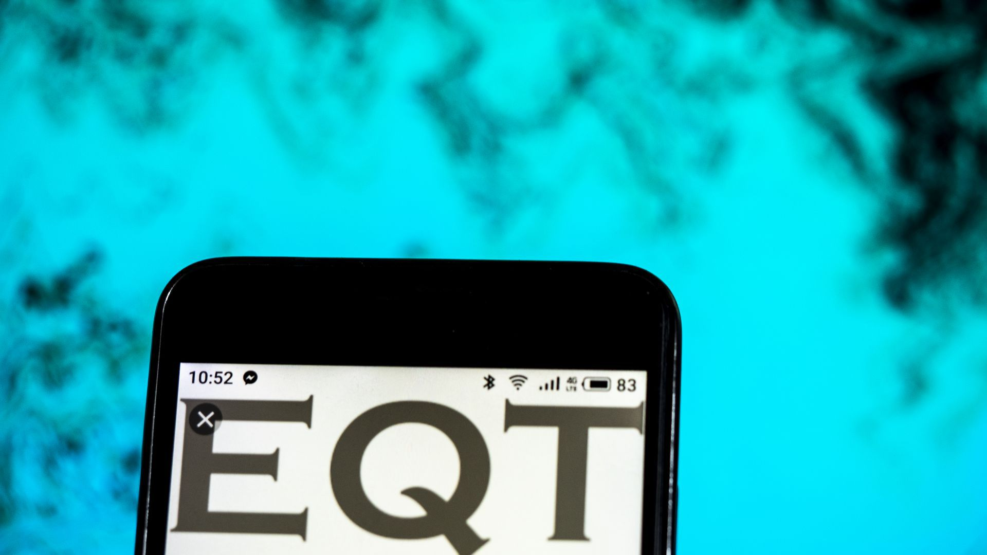 Phone that says EQT on it